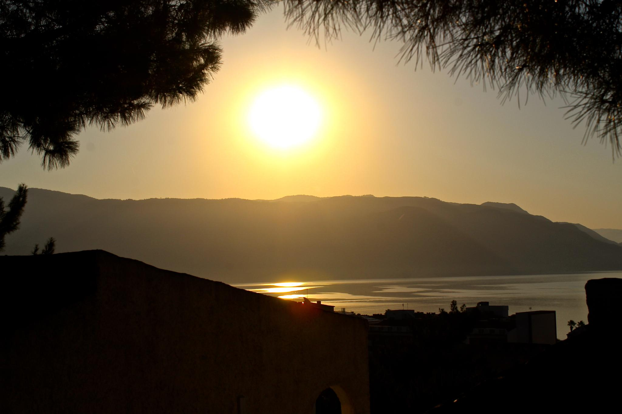 Sun going down in Marmaris - City by John Weijts