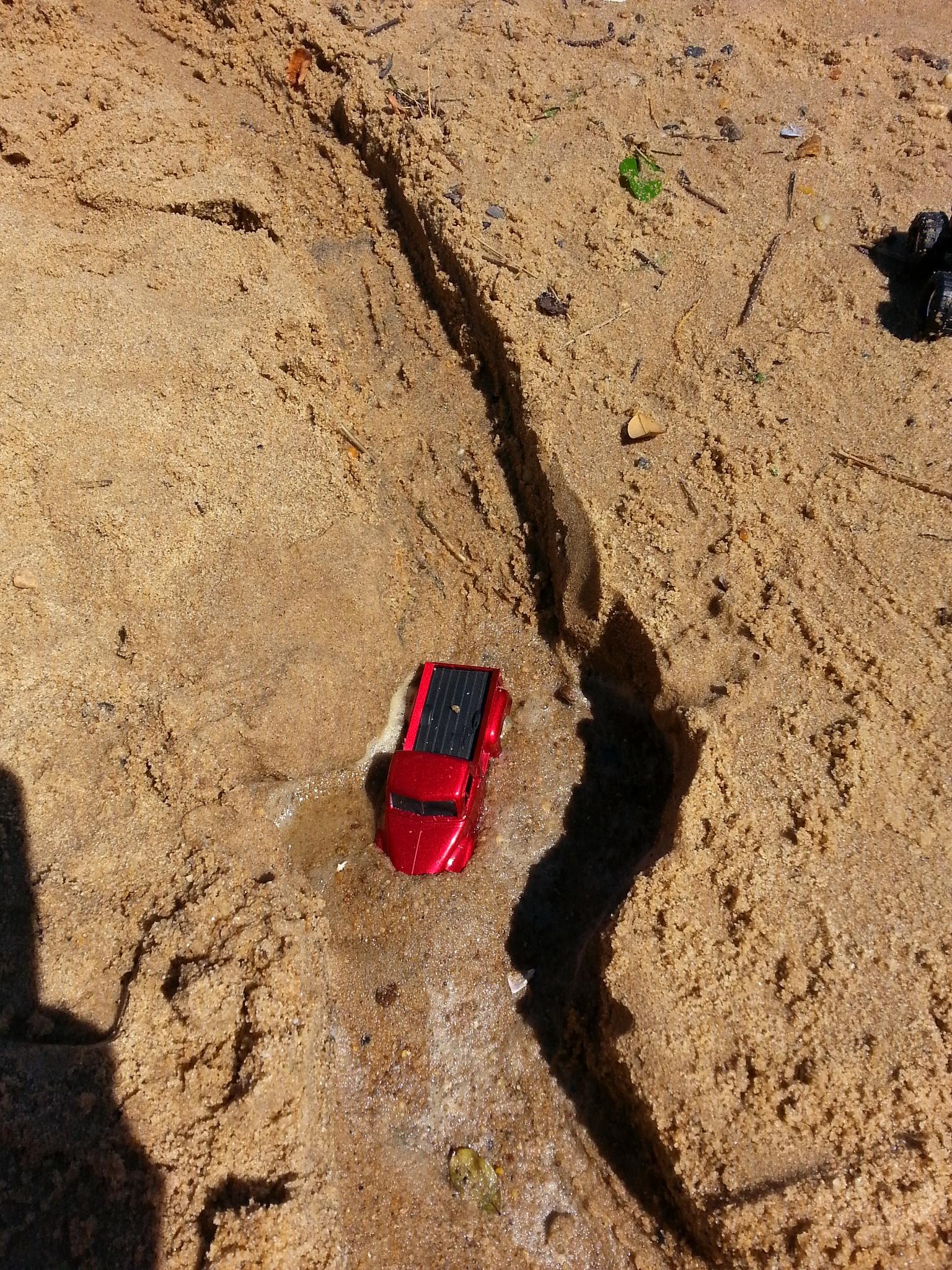 Grandson's truck is stuck in the sand. by Wayne Wilkinson