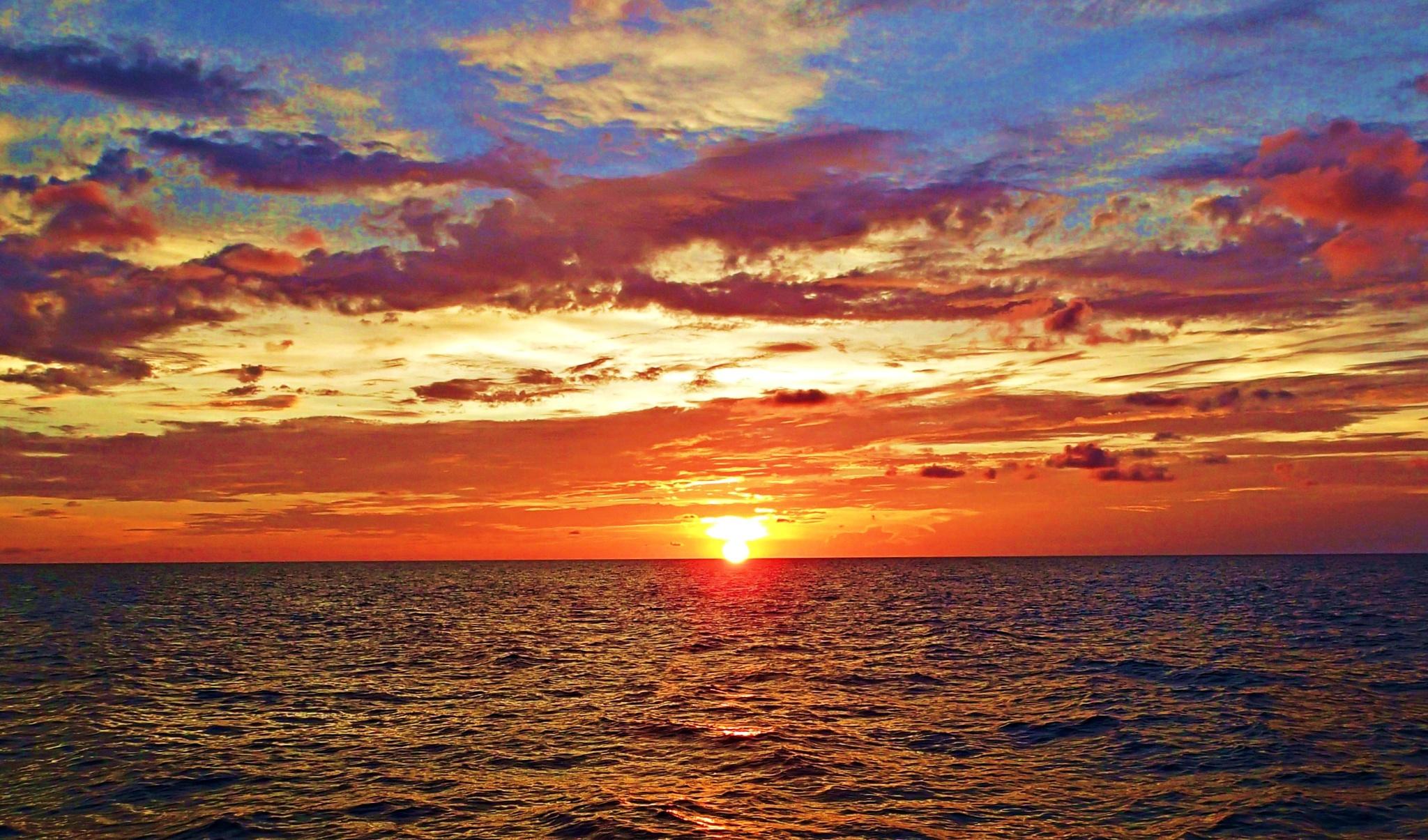 Sunset aboard the Juliet, lost in the Bahamas by Robert Hopkins (Hop) Ridgell