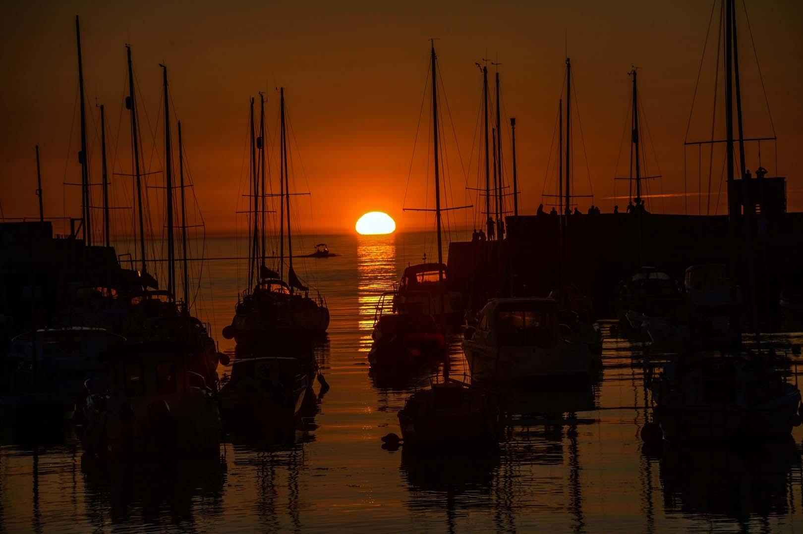 Sun set over the harbor Aberaeron West Wales by andychittockphotohrapher