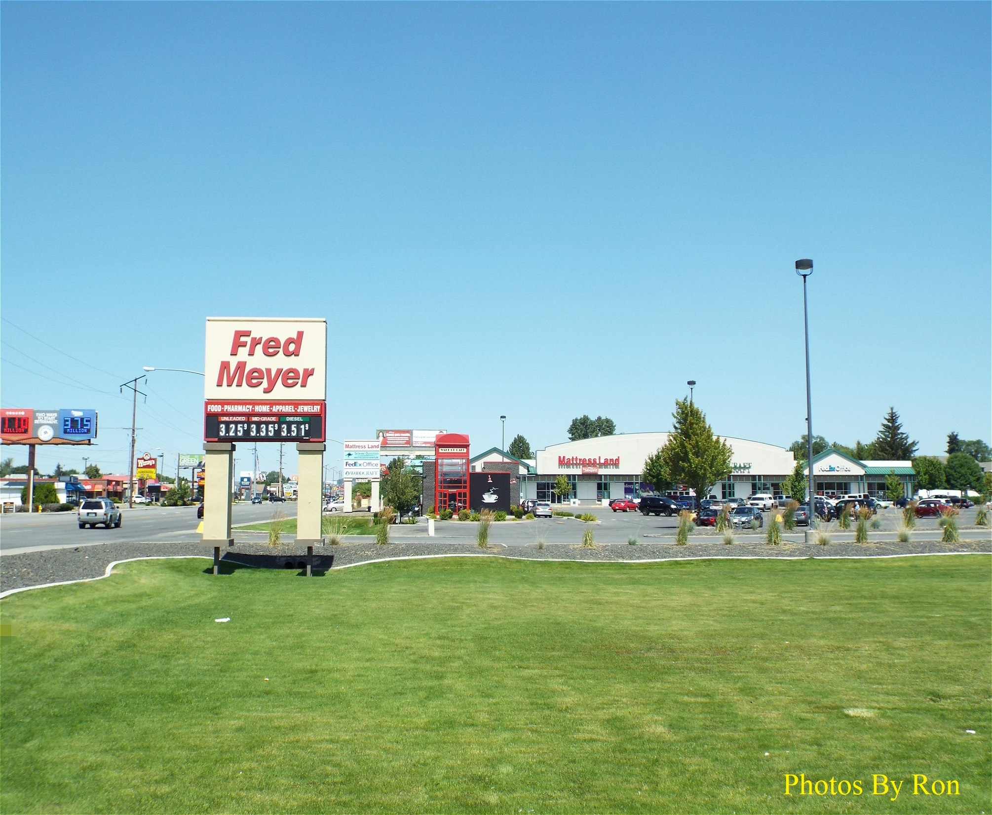 """Looking North At The Fred Meyer Parking Lot & Wake Up Call Coffee Shop"""" by Ron Berkley"""