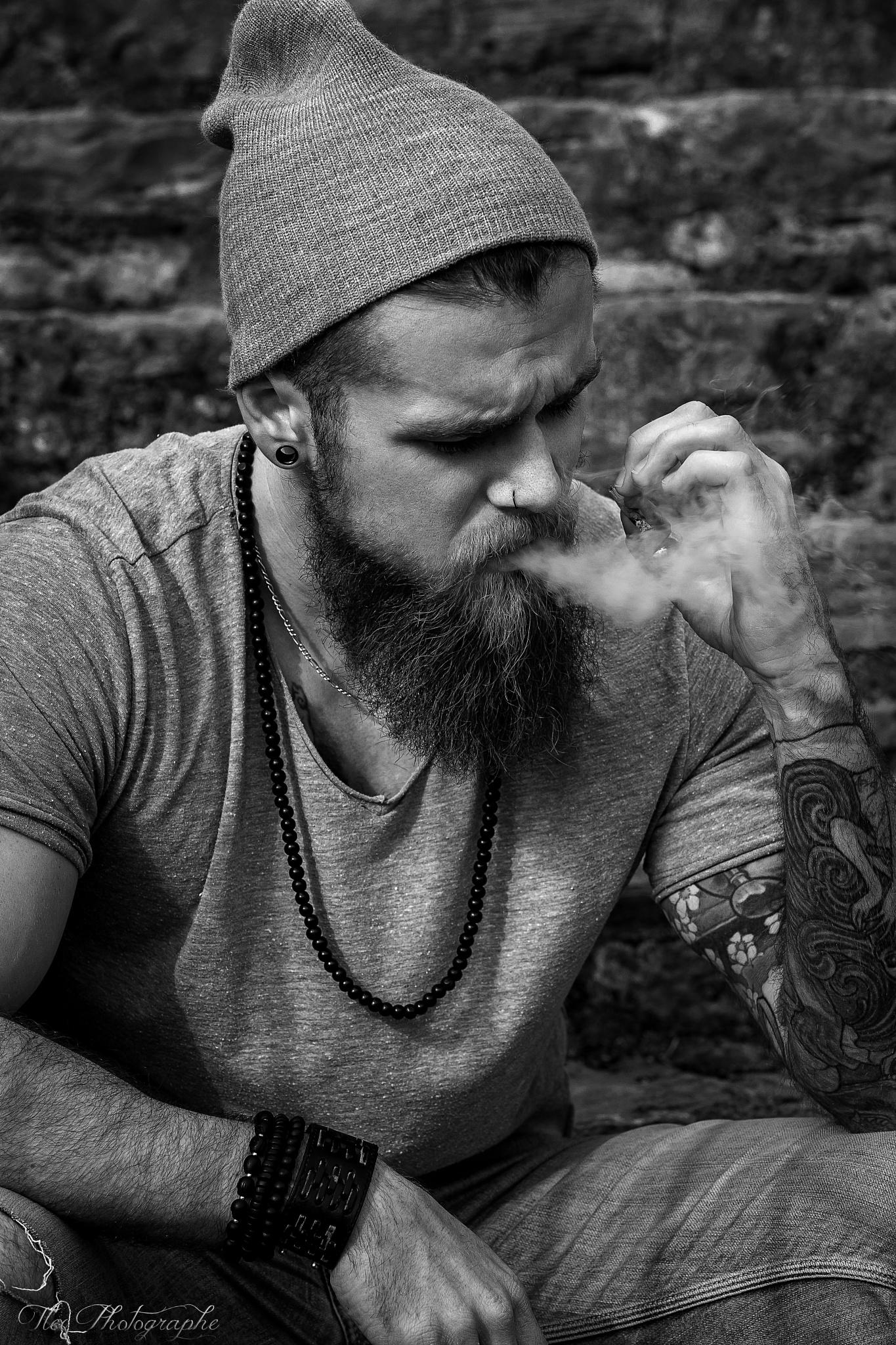 Photo in Portrait #portrait #face #barbu #barbe #ink #inked #tattoos #smoke #fumée #cigarette #black and white #noir et blanc #b&w #n&b #natural #piercing #hipster #homme #man #boy