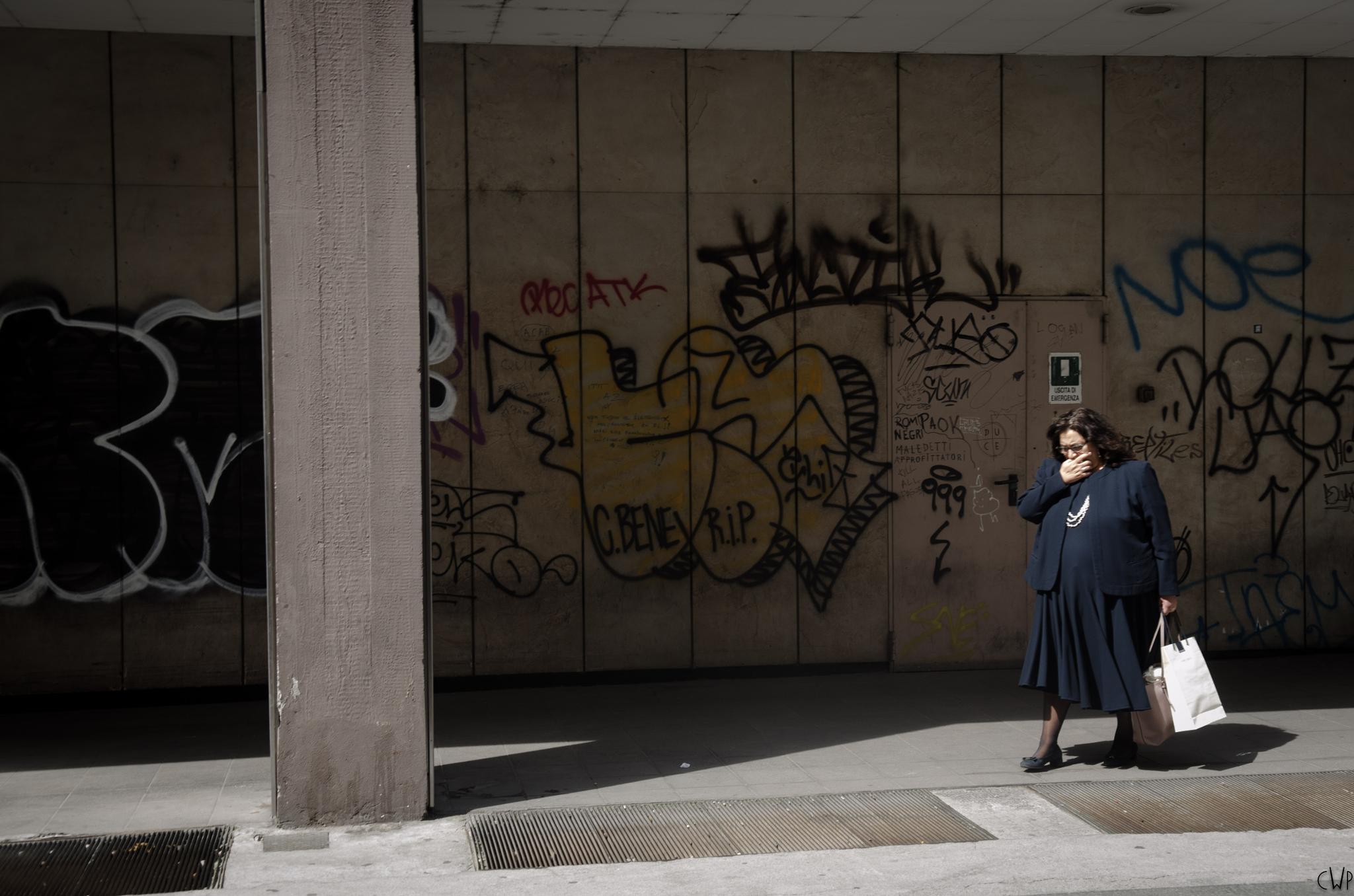 Lady Yawns at Graffiti  by Charlie Watkins