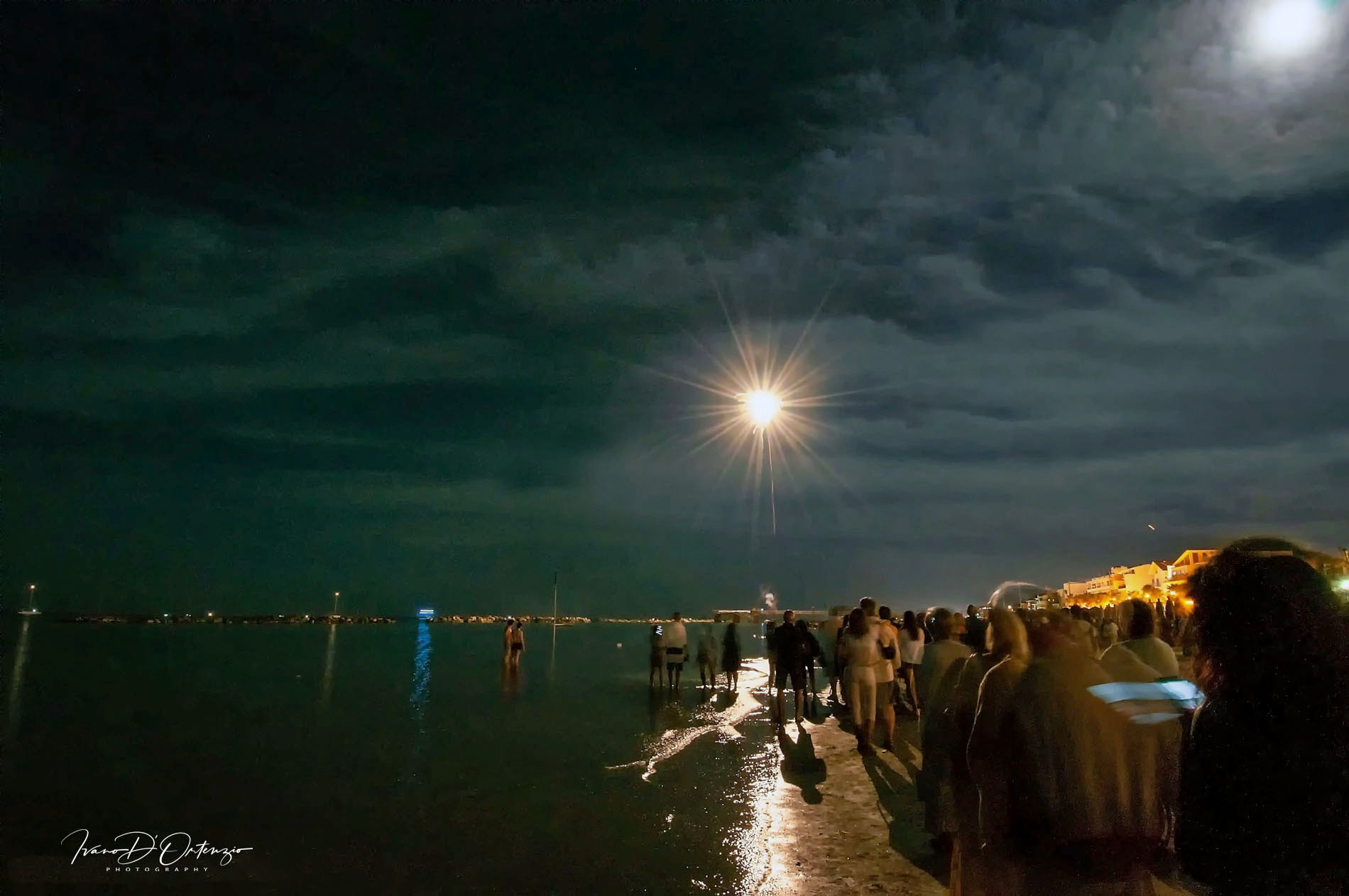 Photo in Sea and Sand #notte #luci #gente #water #sea #color #people