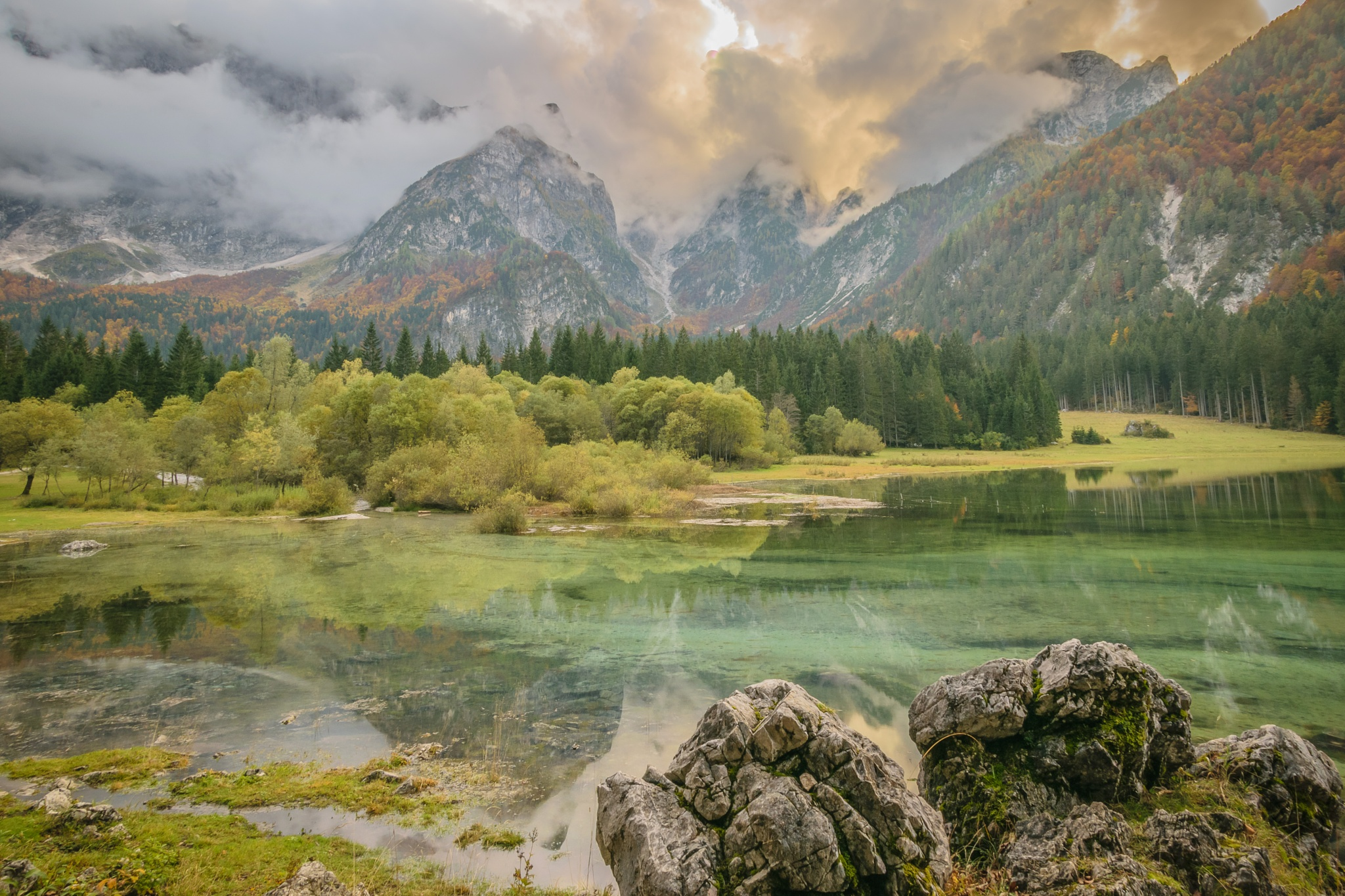 Misty mountains by the lake by Erik Smrekar