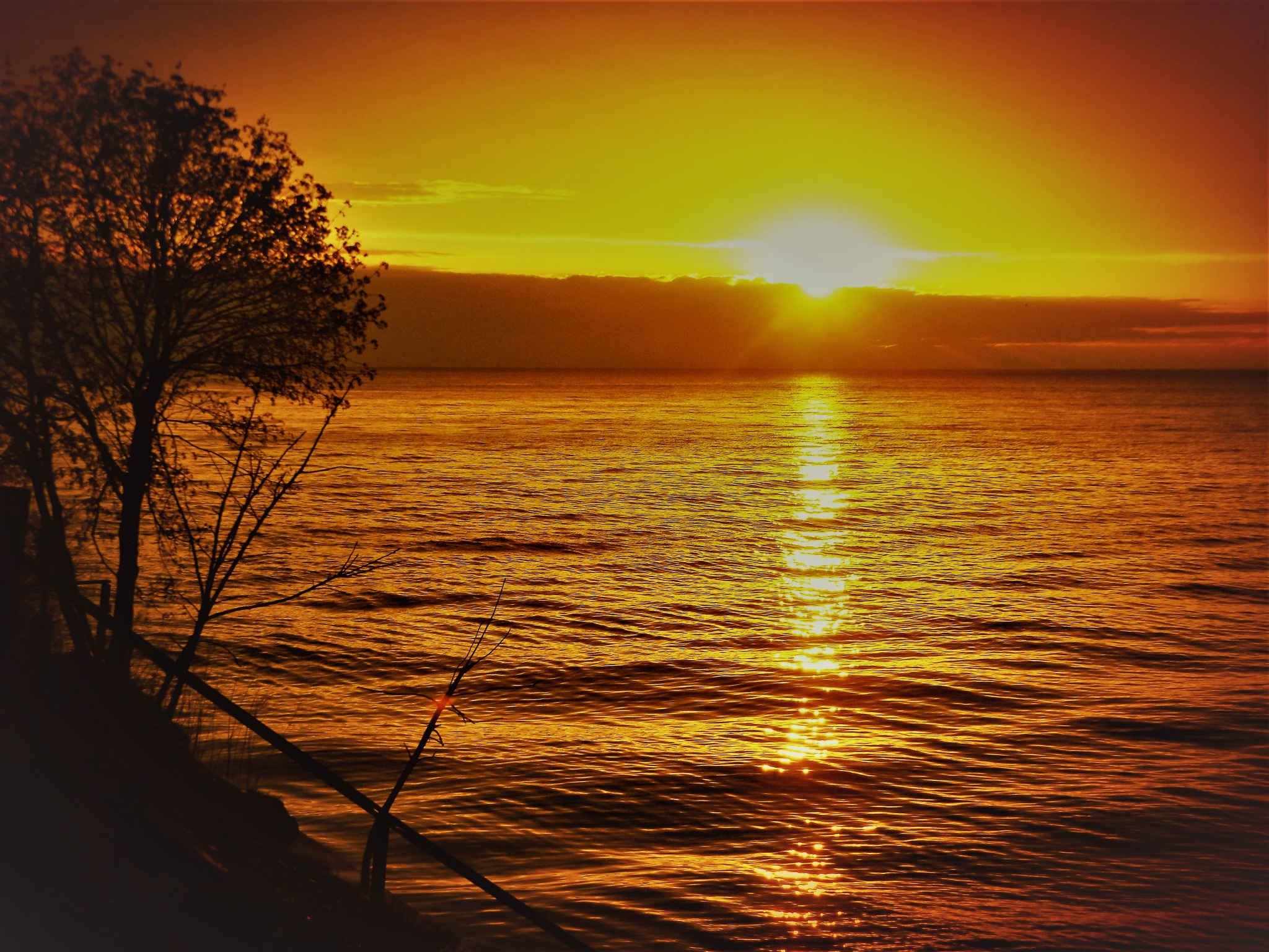 ANOTHER BEAUTIFUL SUNSET ON LAKE ONTARIO IN LYNDONVILLE, NY by Dawn Hoffmeister