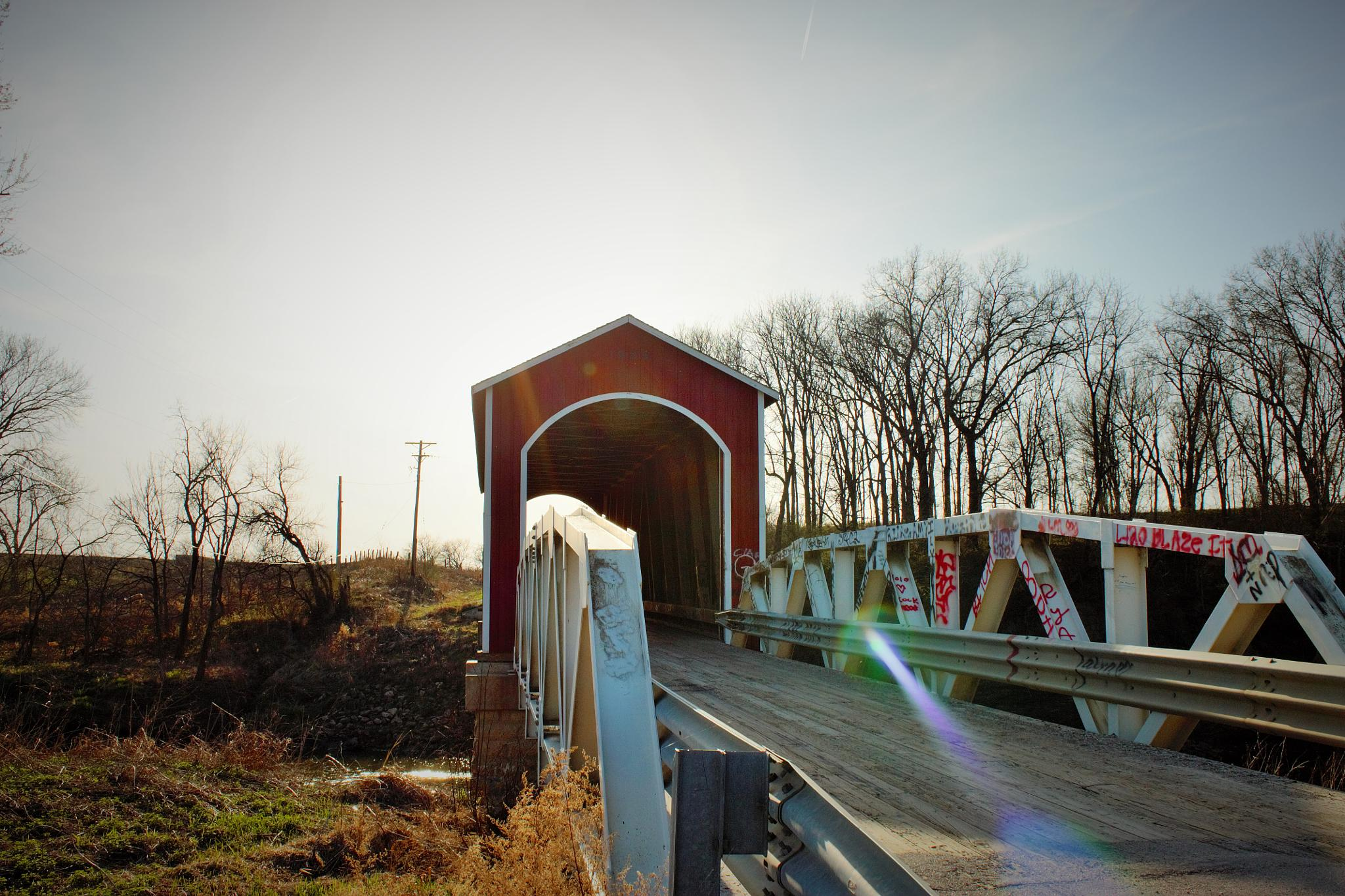 Sun Flare through the bridge by MissyP87
