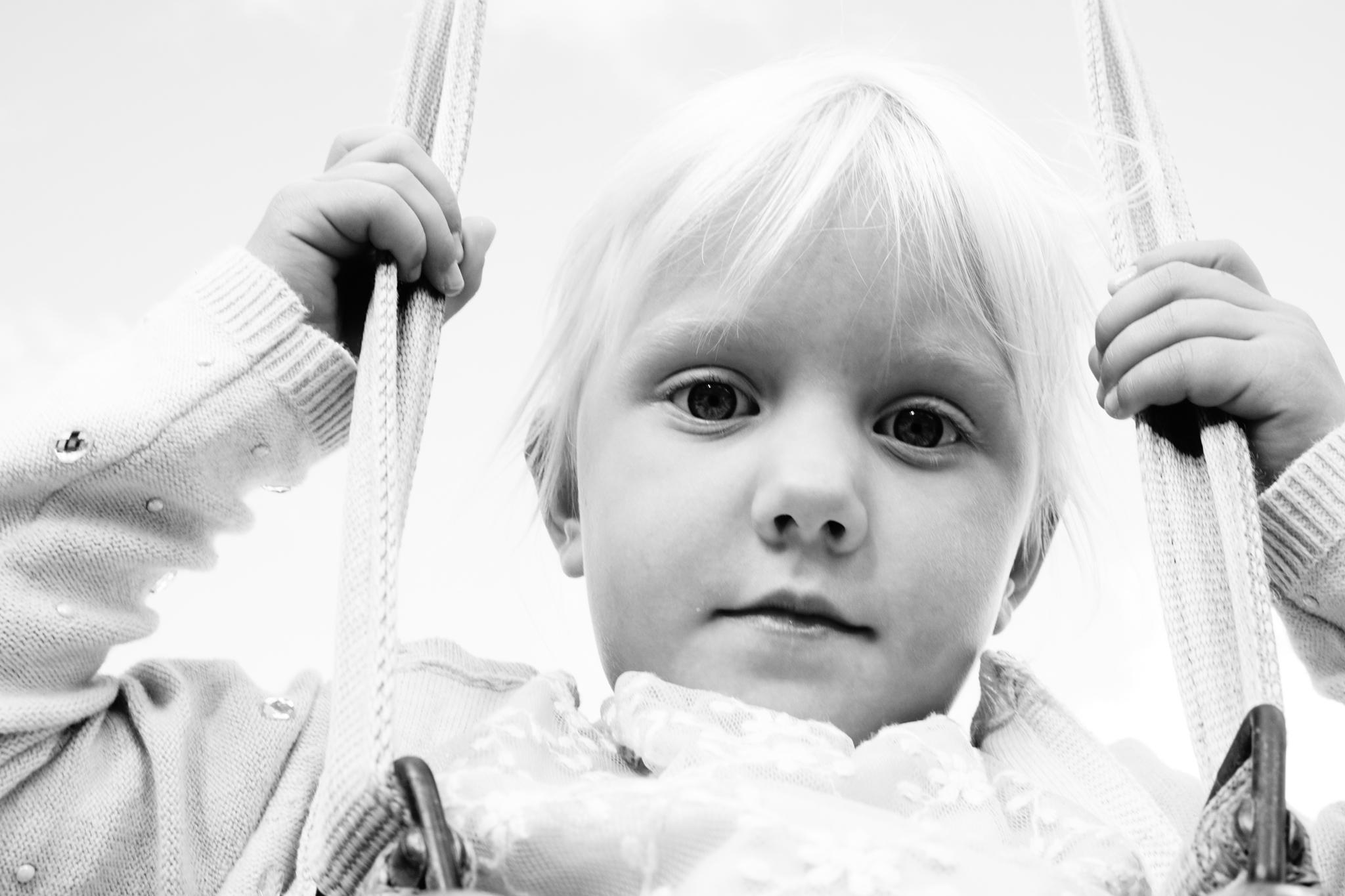 Little girl in a swing by Nille.N