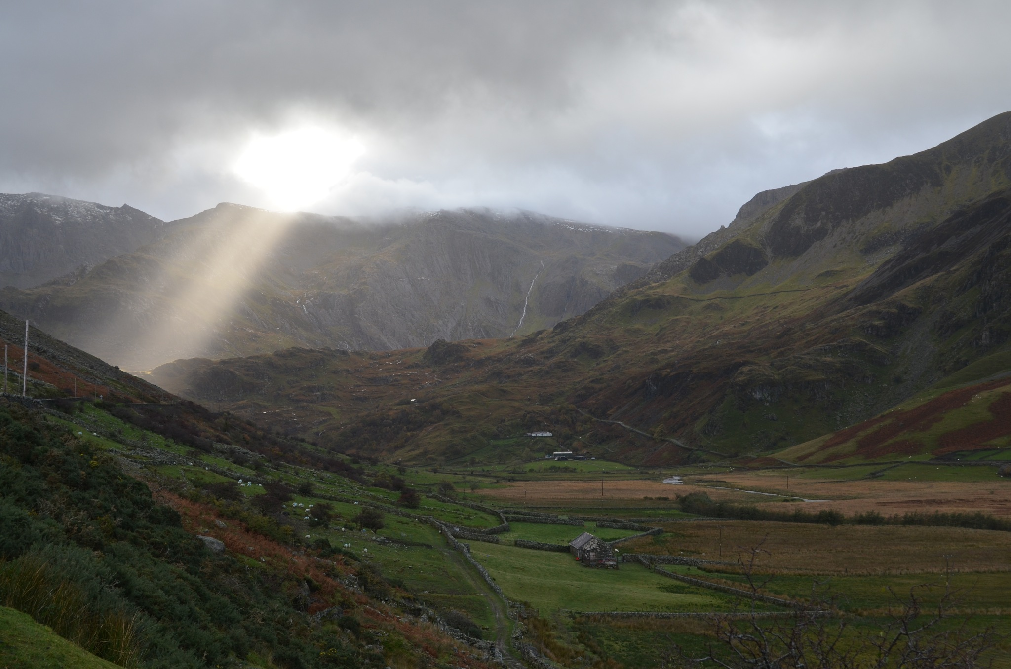 sunlight breaking through  the cloads Ogwen Valley by adrian.williams.58323