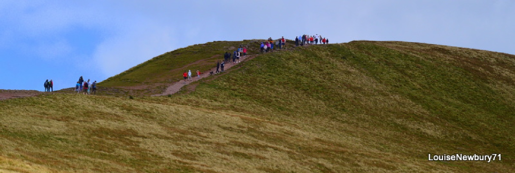 Walkers making their way to the peak by louise.newbury