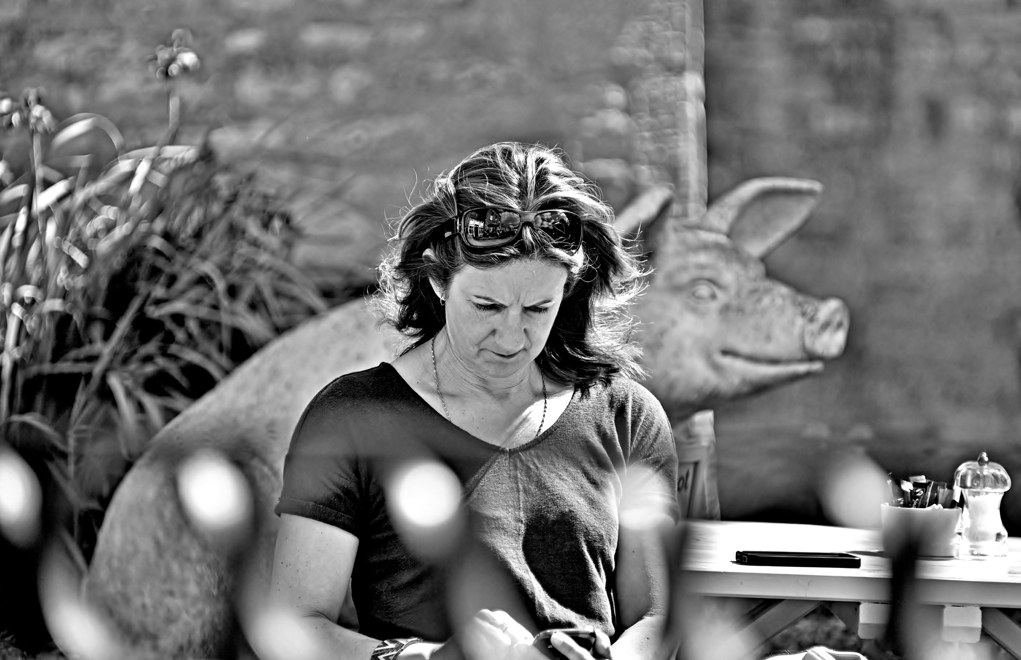 Woman Phoning - Pig Smiling - Monochrome by paul.hosker