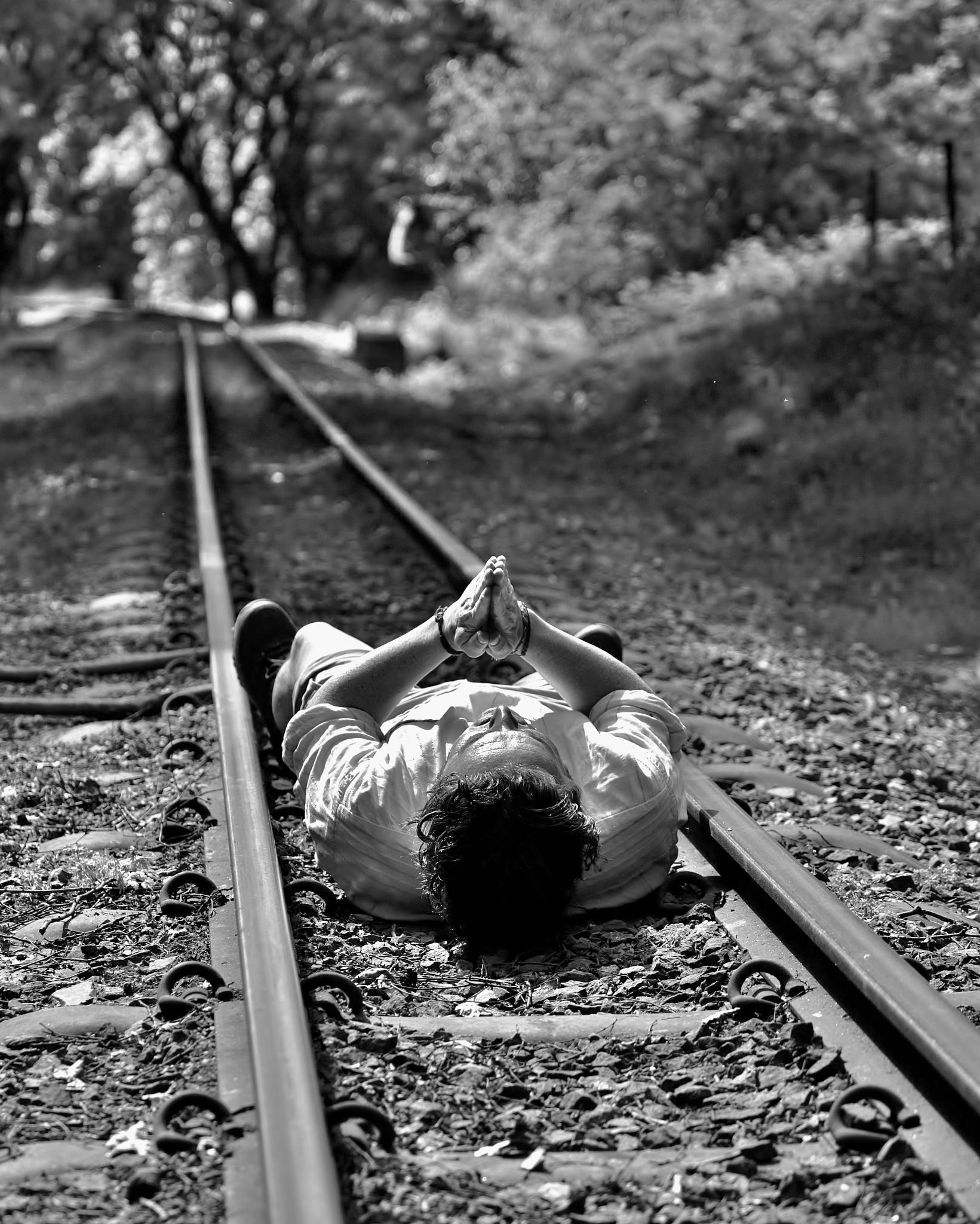 Photo in Black and White #rail #rail track #man #praying #people #art #monochrome #black and white #train