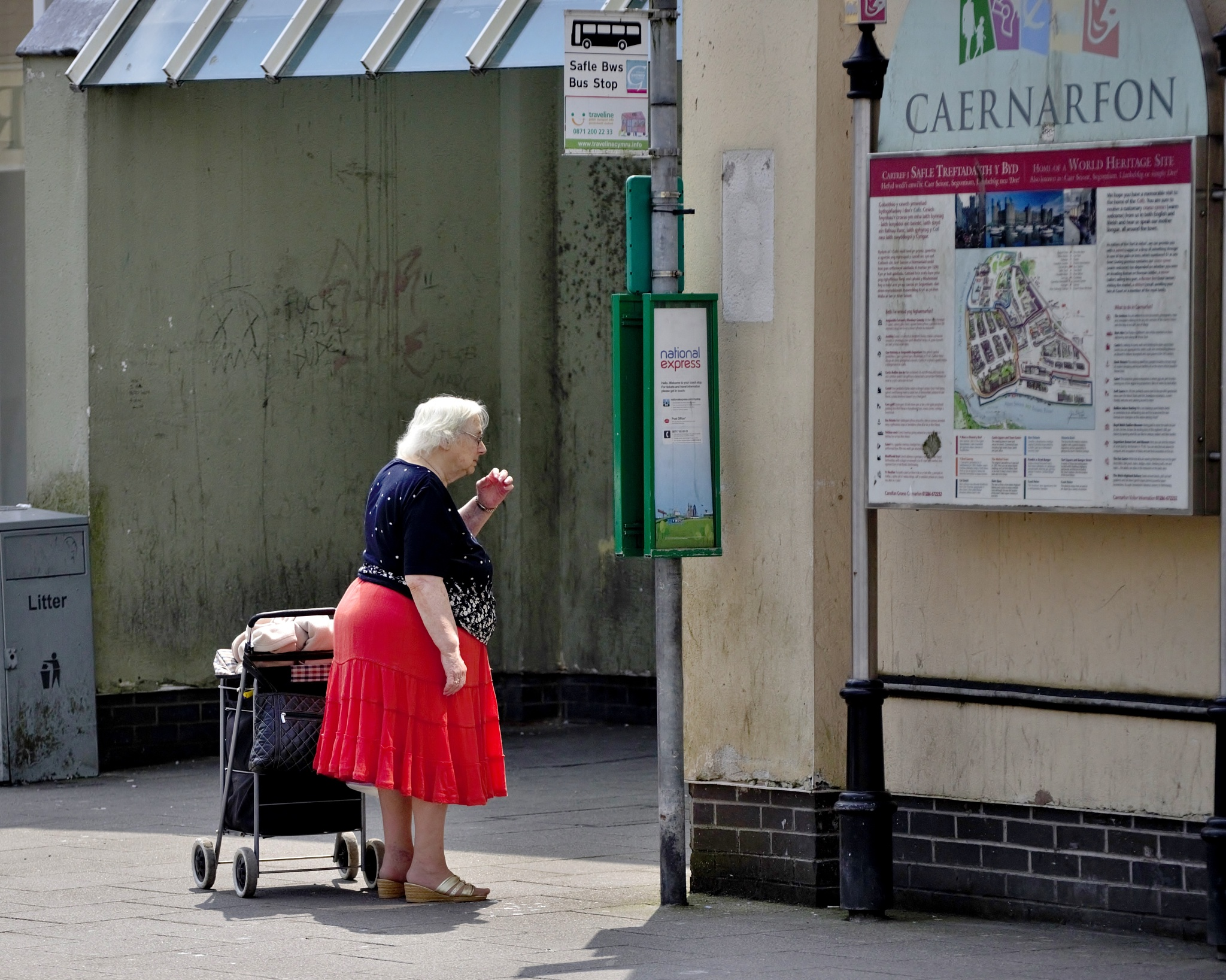 Photo in People #people #bus stop #woman #older #old