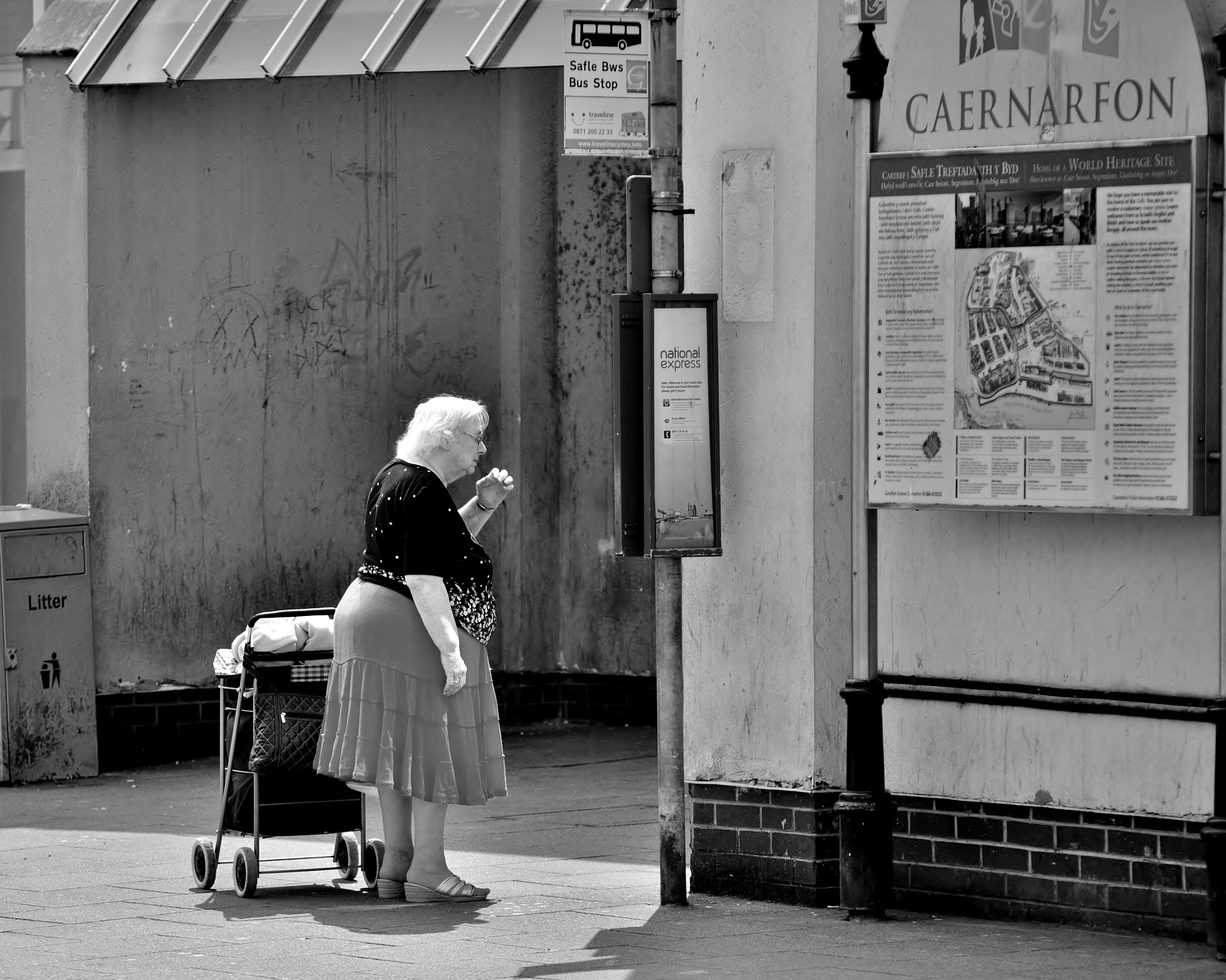 Older Woman At A Bus Stop - Caernarfon - Monochrome by paul.hosker