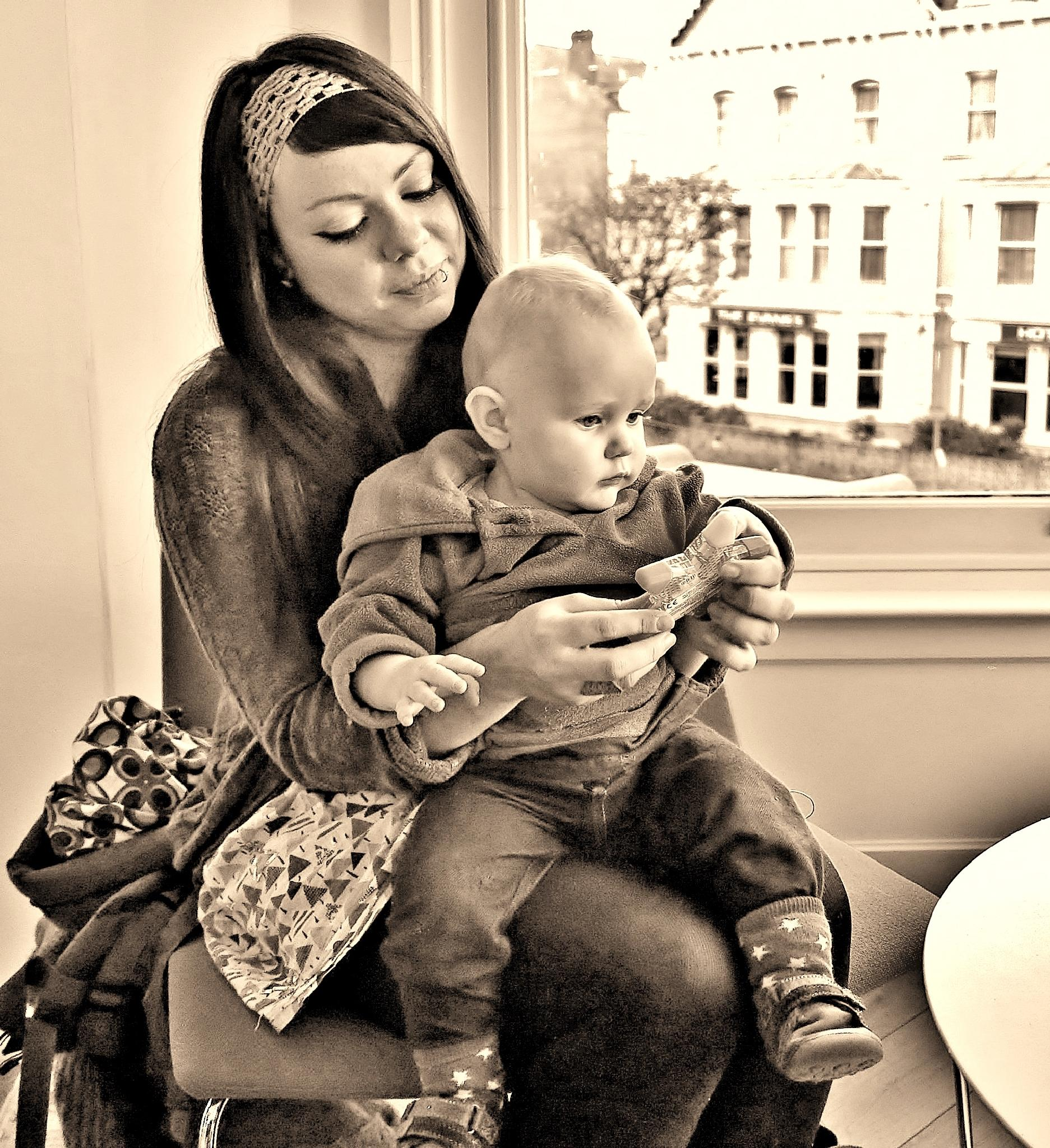 Mother & Child Play in Cafe - Monochrome by paul.hosker