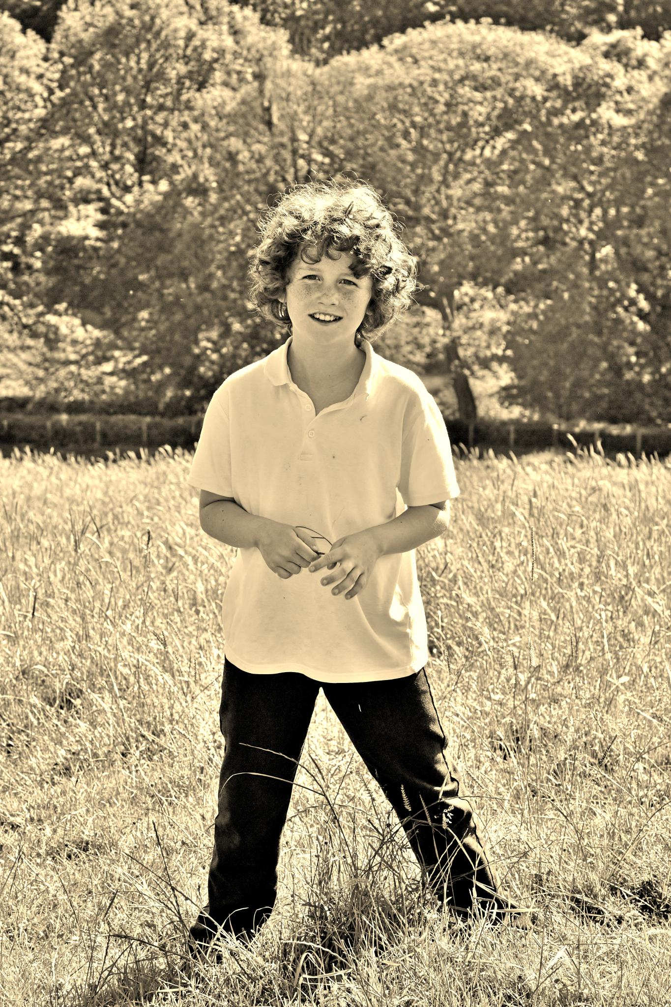 Boy in a Meadow - North Wales - Sepia by paul.hosker