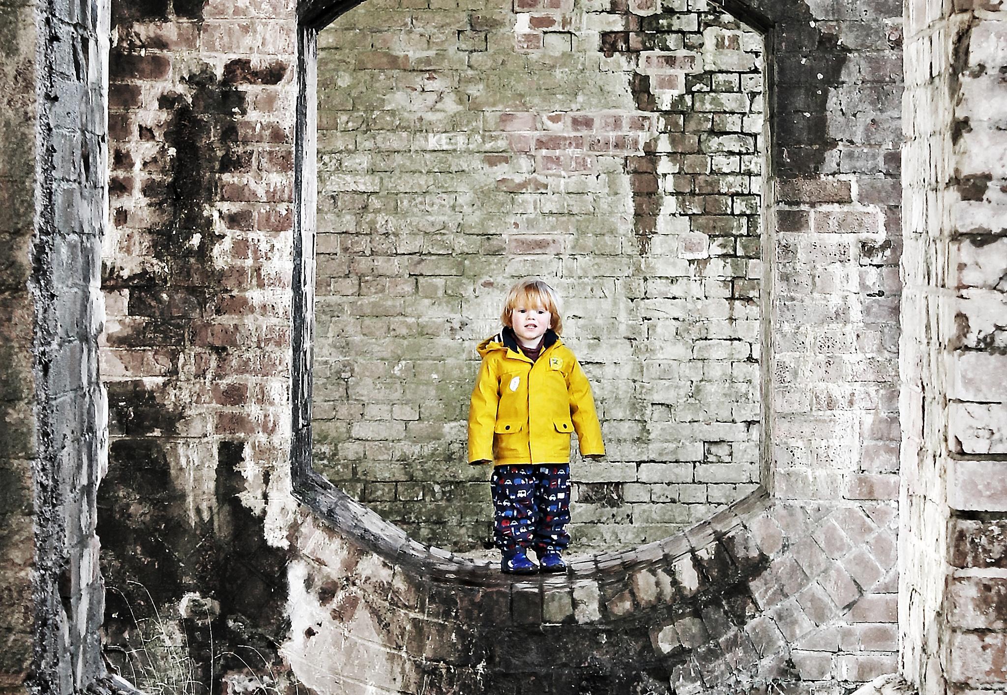 boy in a yellow coat by David R Murphy