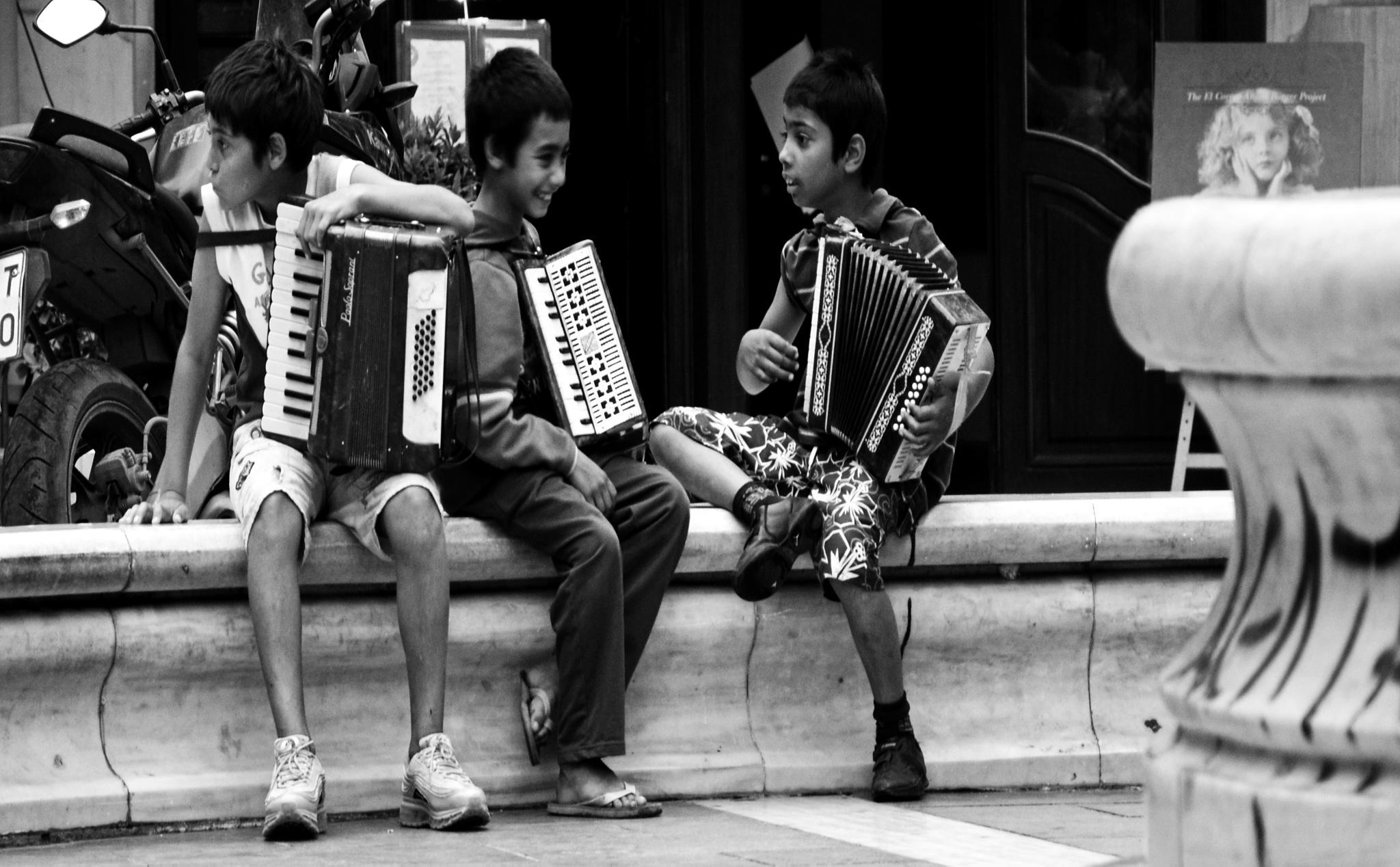 Happy (?) children by Nikolakos