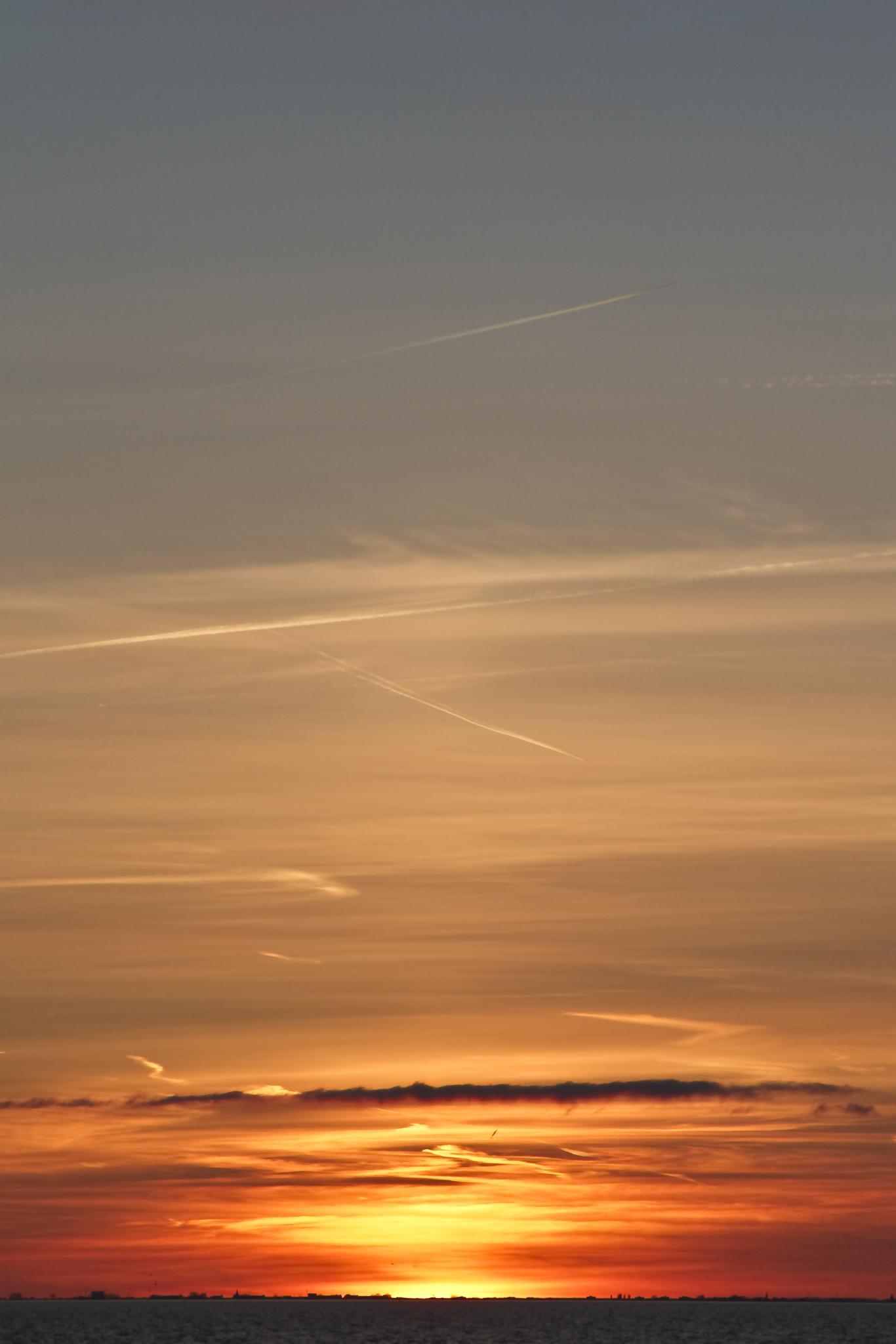 Sunset over Amsterdam from Almere by danielle.klaveroverdijk