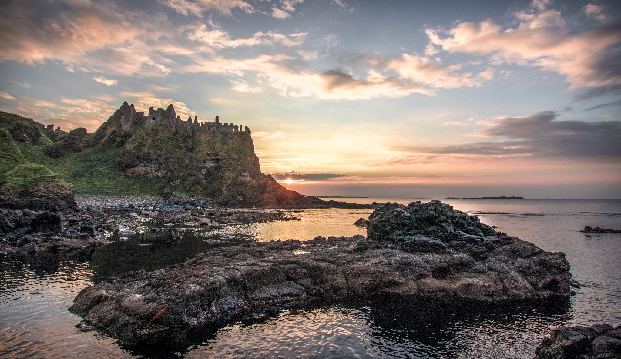 Dunluce Castle at sunset by Eddie Spence