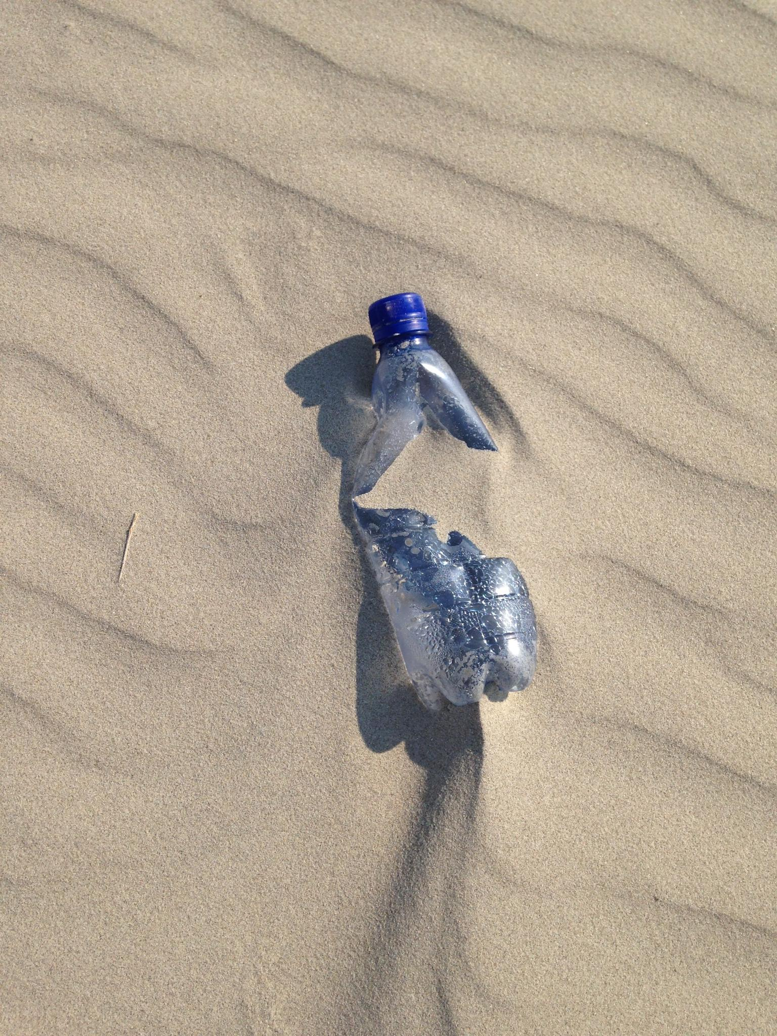 water bottle on the beach by marianne.post.376