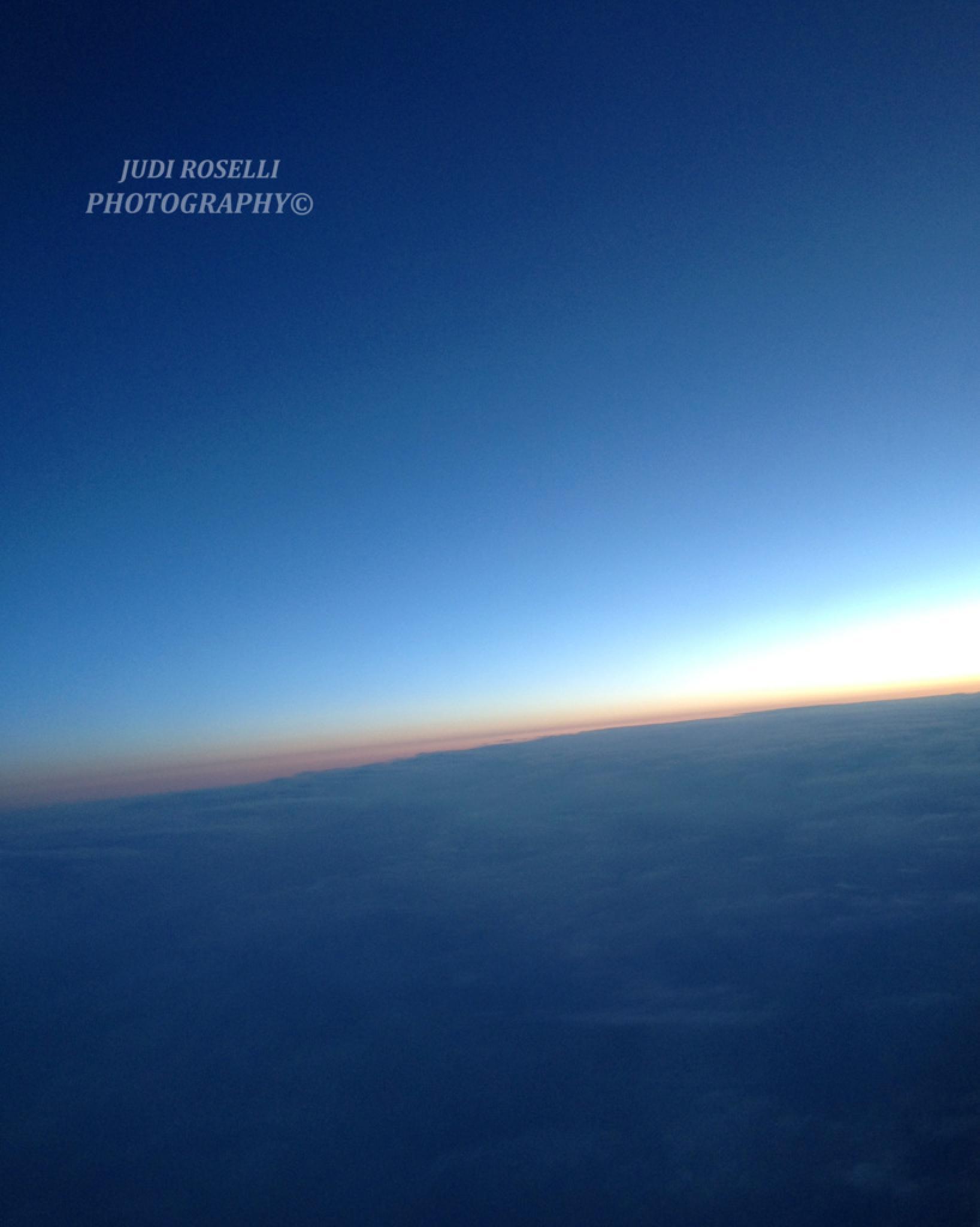 SUN RISING ABOVE THE CLOUDS by JUDI ROSELLI