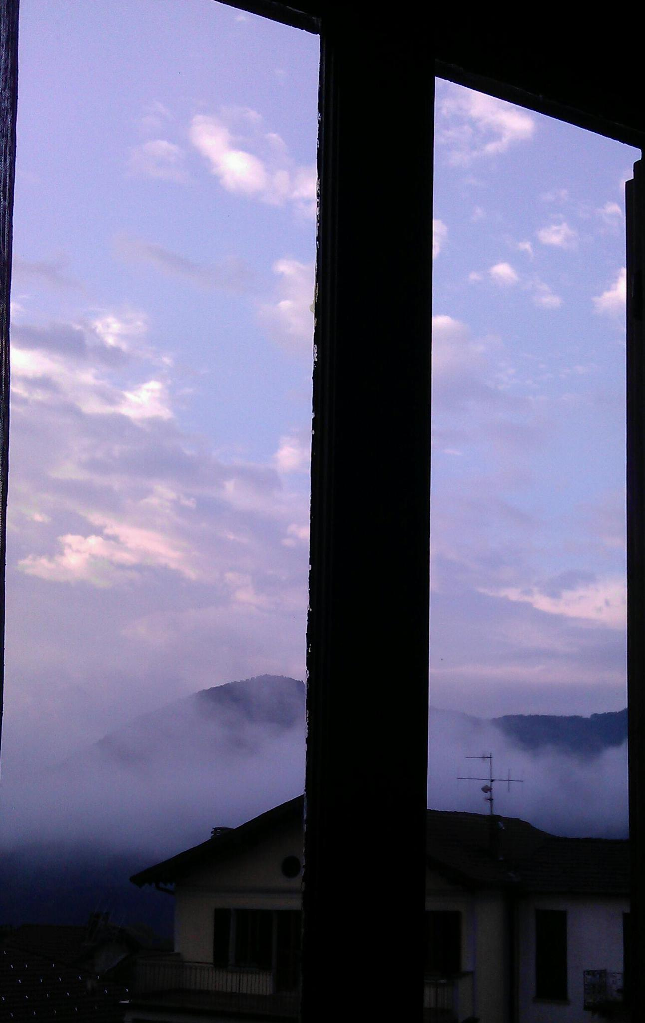 A little of clouds by my window. by Paolo Pasquali