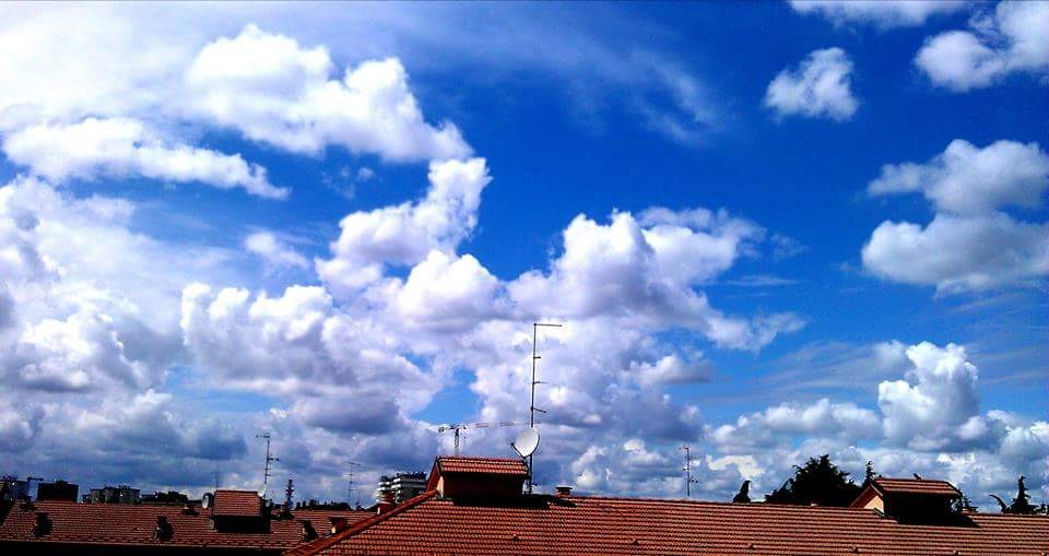 Clouds on the roofs by Paolo Pasquali