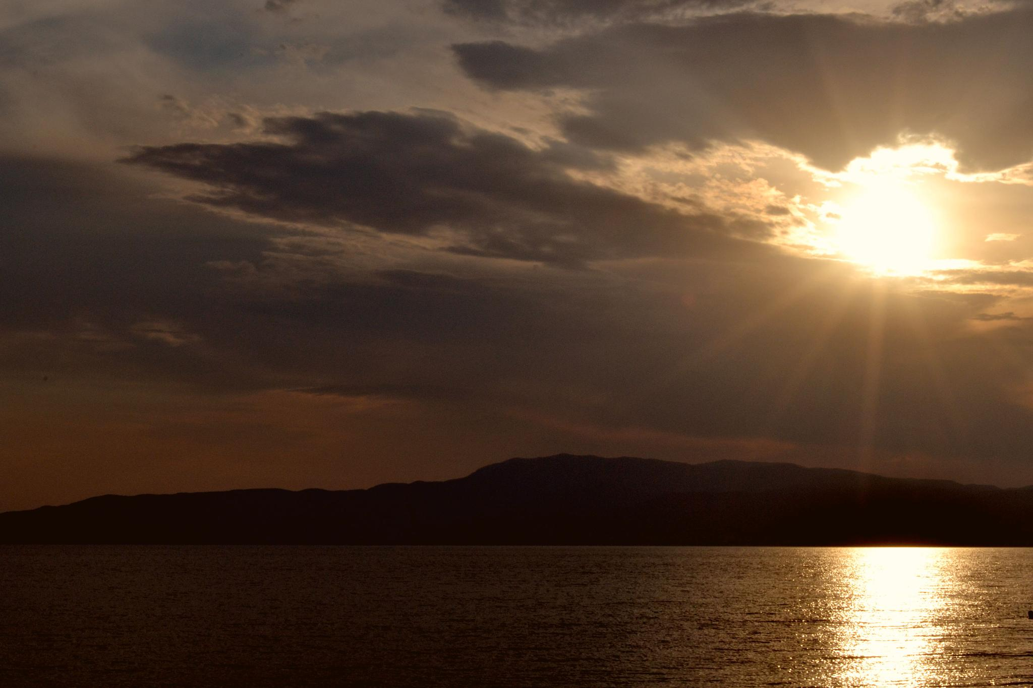 sun wants ..to lean on the sea! by angeliki