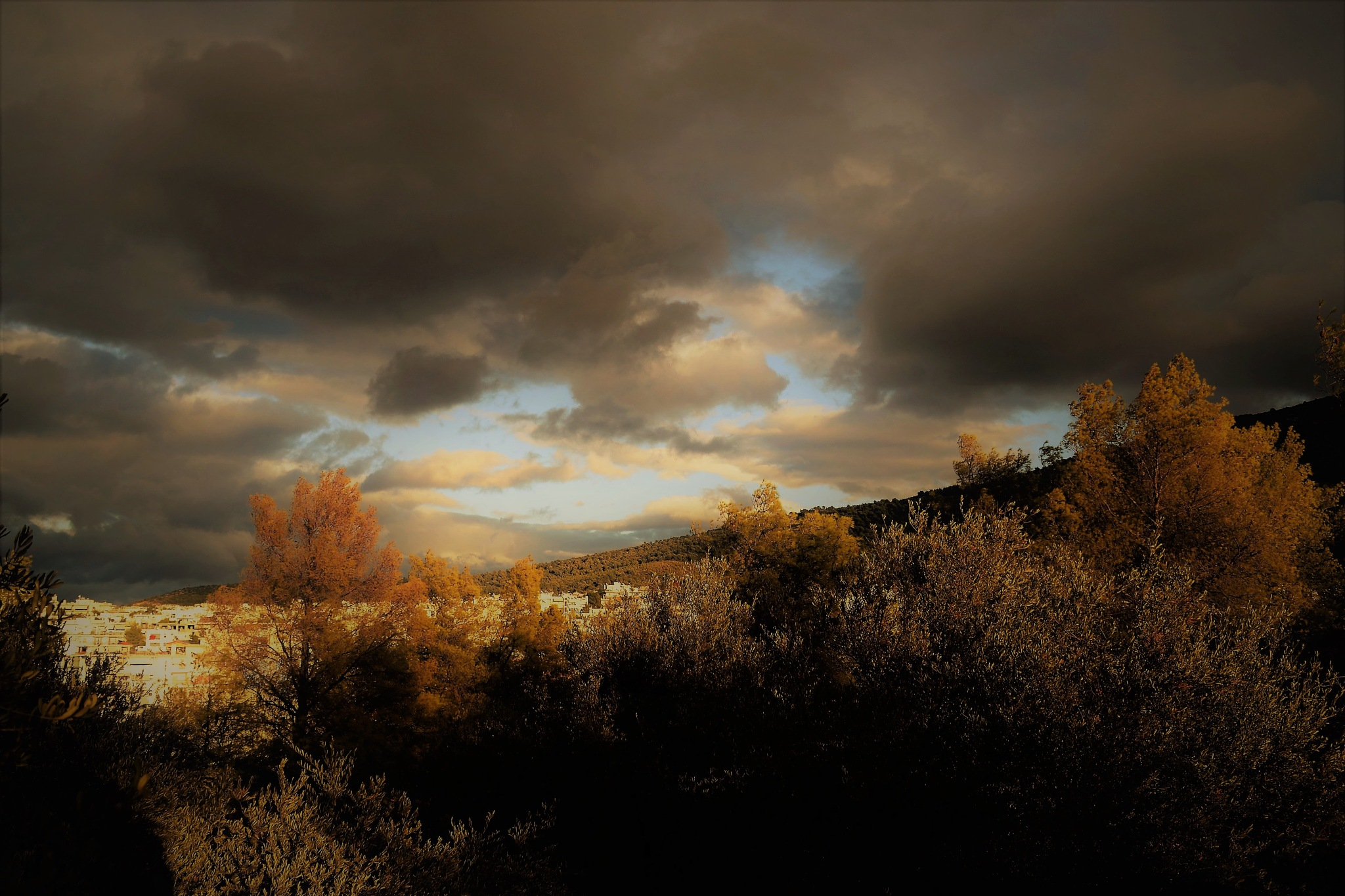 clouds vs sunlight :-) by angeliki
