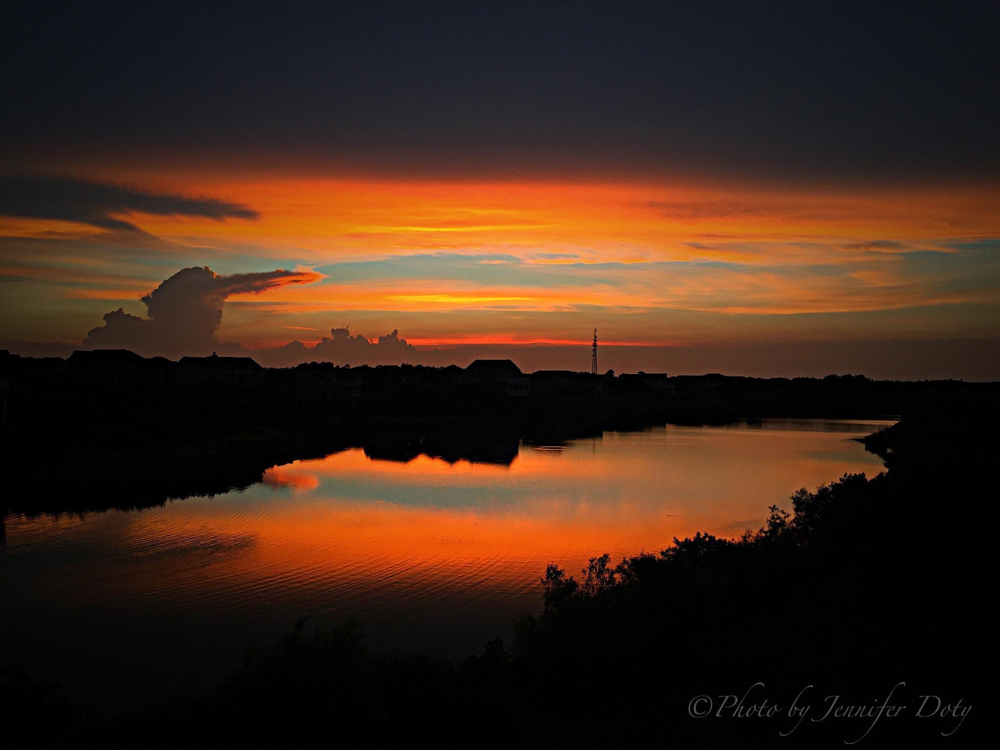 Sunset over neighborhood lake - Corolla, North Carolina  by Jennifer Doty