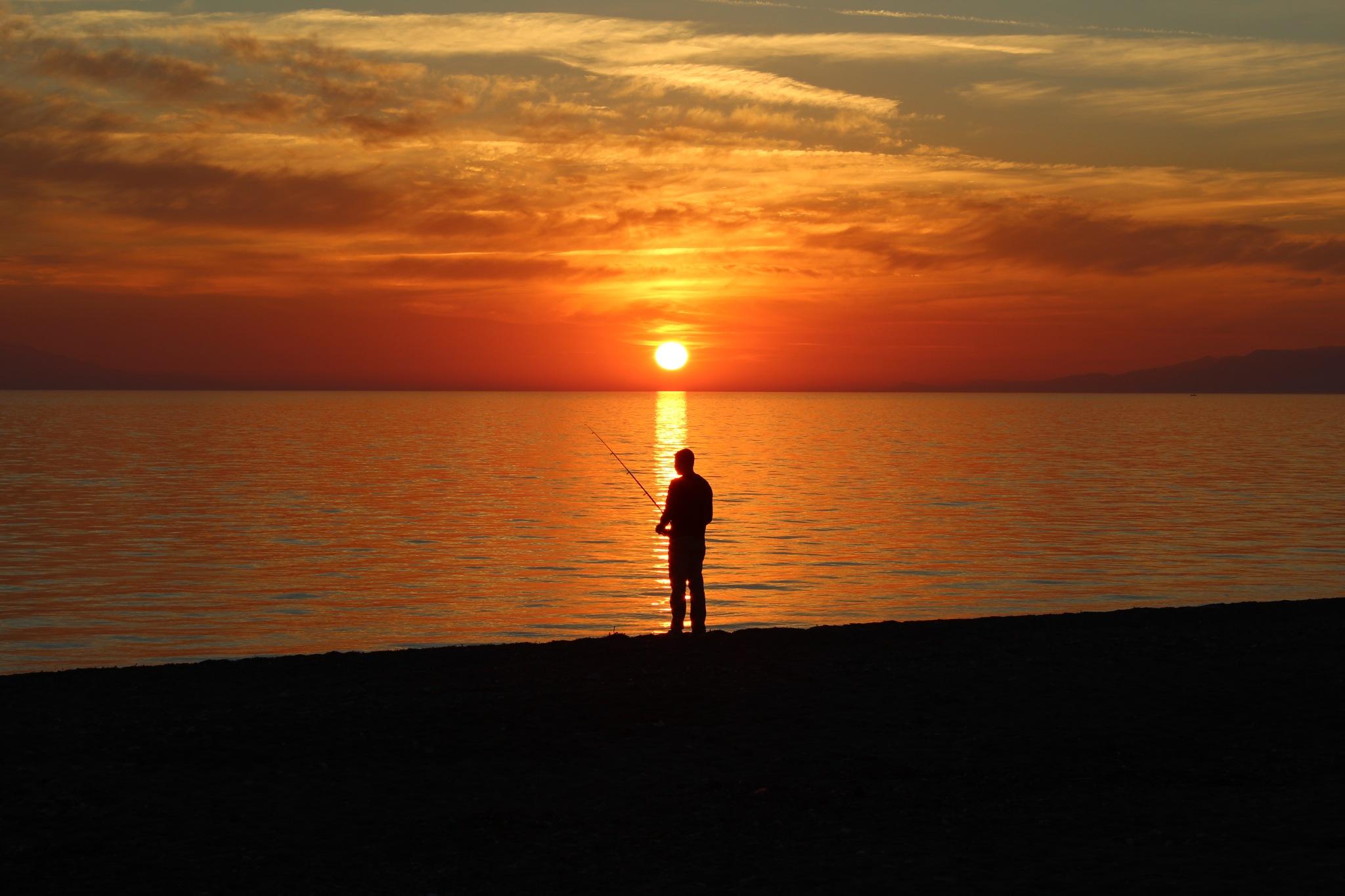 sunset and fisherman  by Feza Uncu