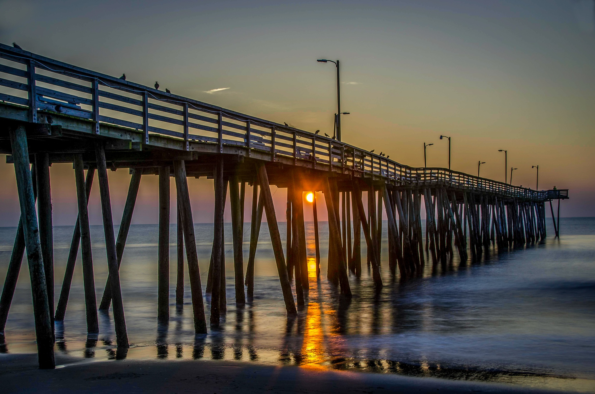 Sunrise under the Pier by CharlieWilson