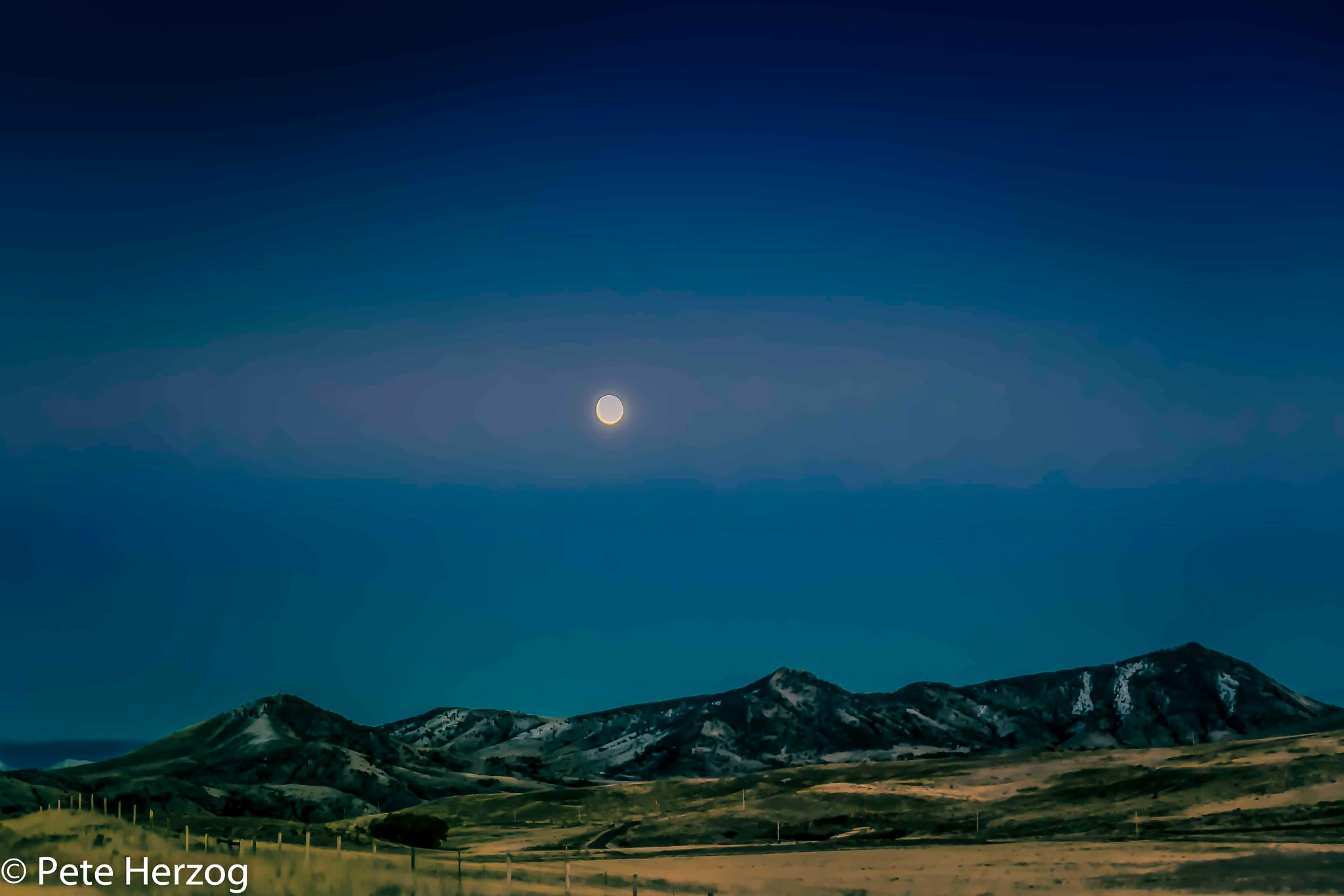 Moon over Mountains in Montana by peter.herzog.3323