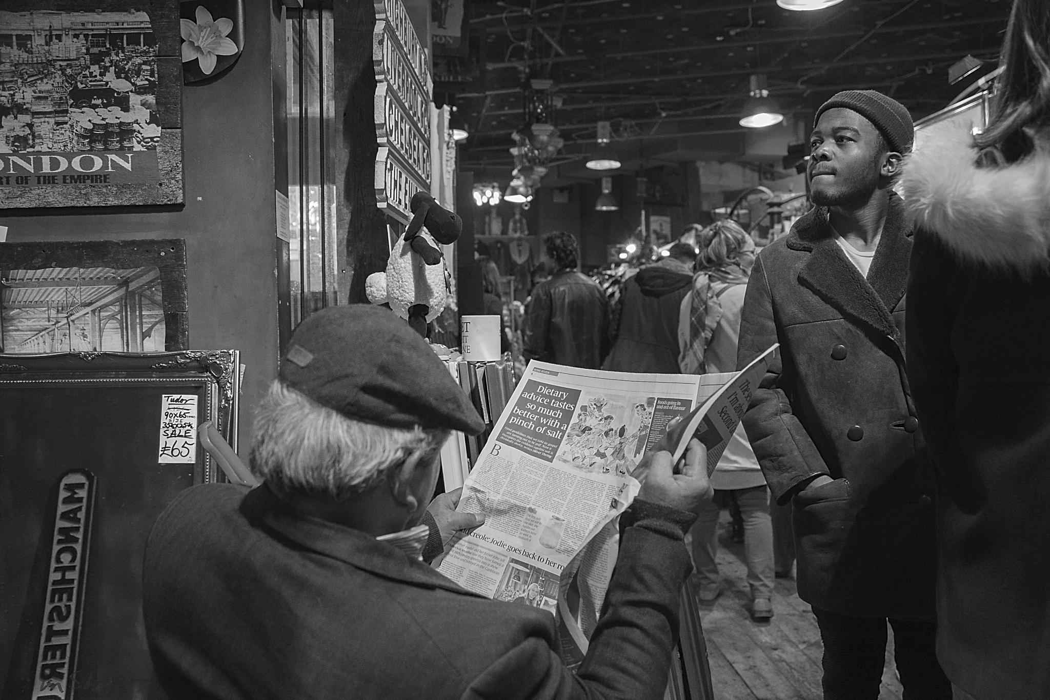 Man reading a newspaper by Darek Baranowski