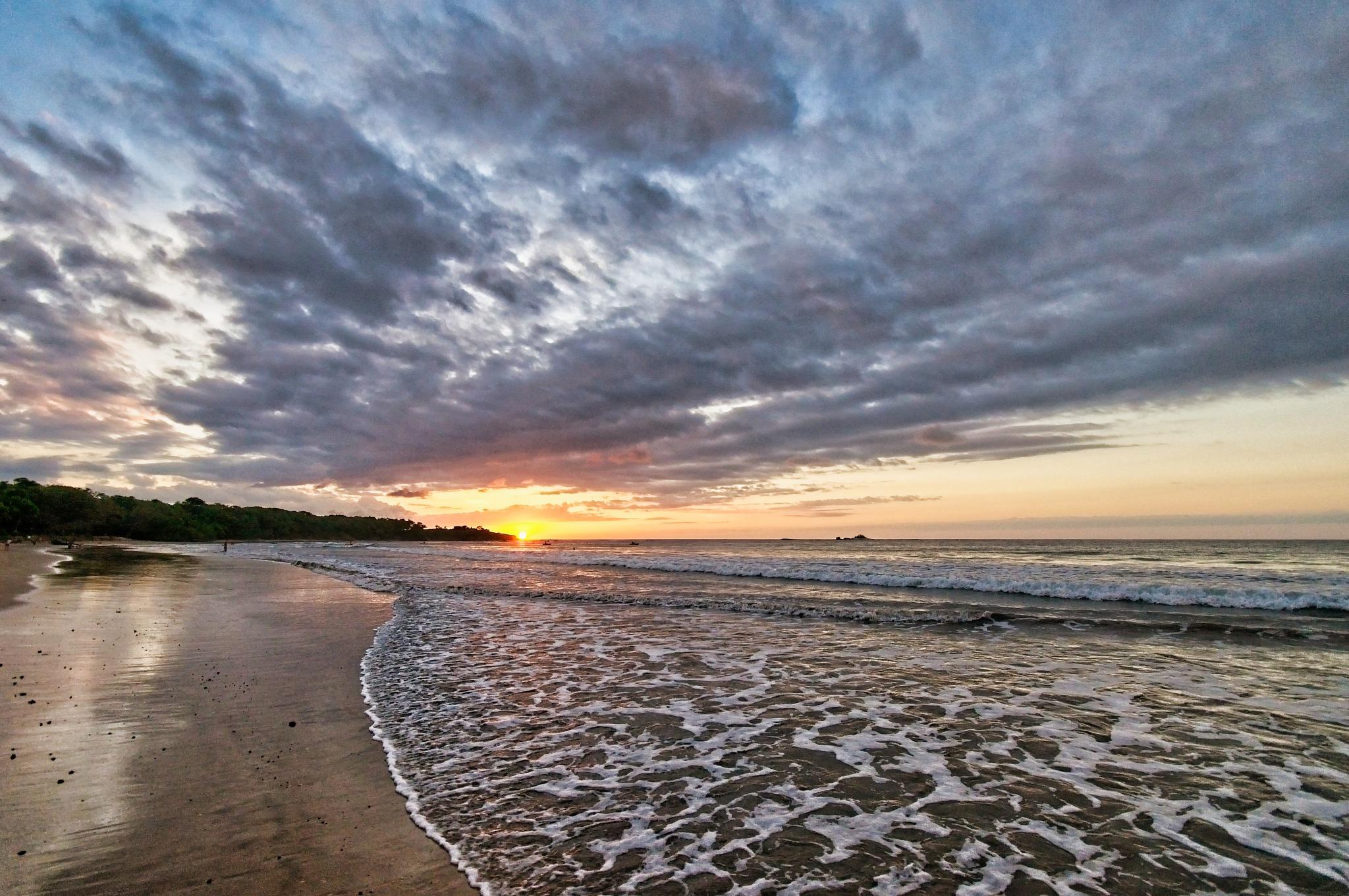 Photo in Landscape #playa tamarindo #clouds #ocean #sunset #island #light