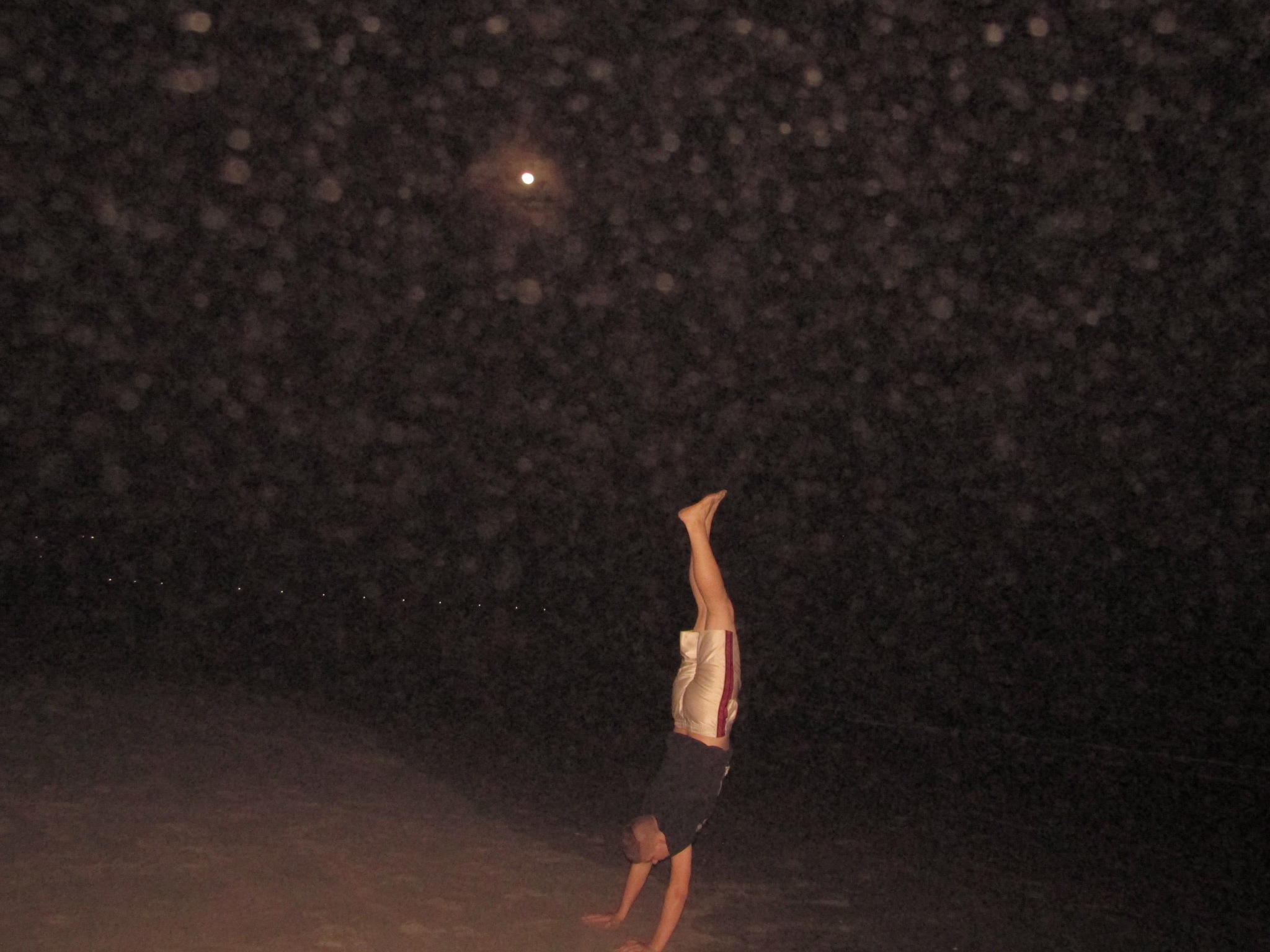 Hand stand on the beach. by Alex Maree