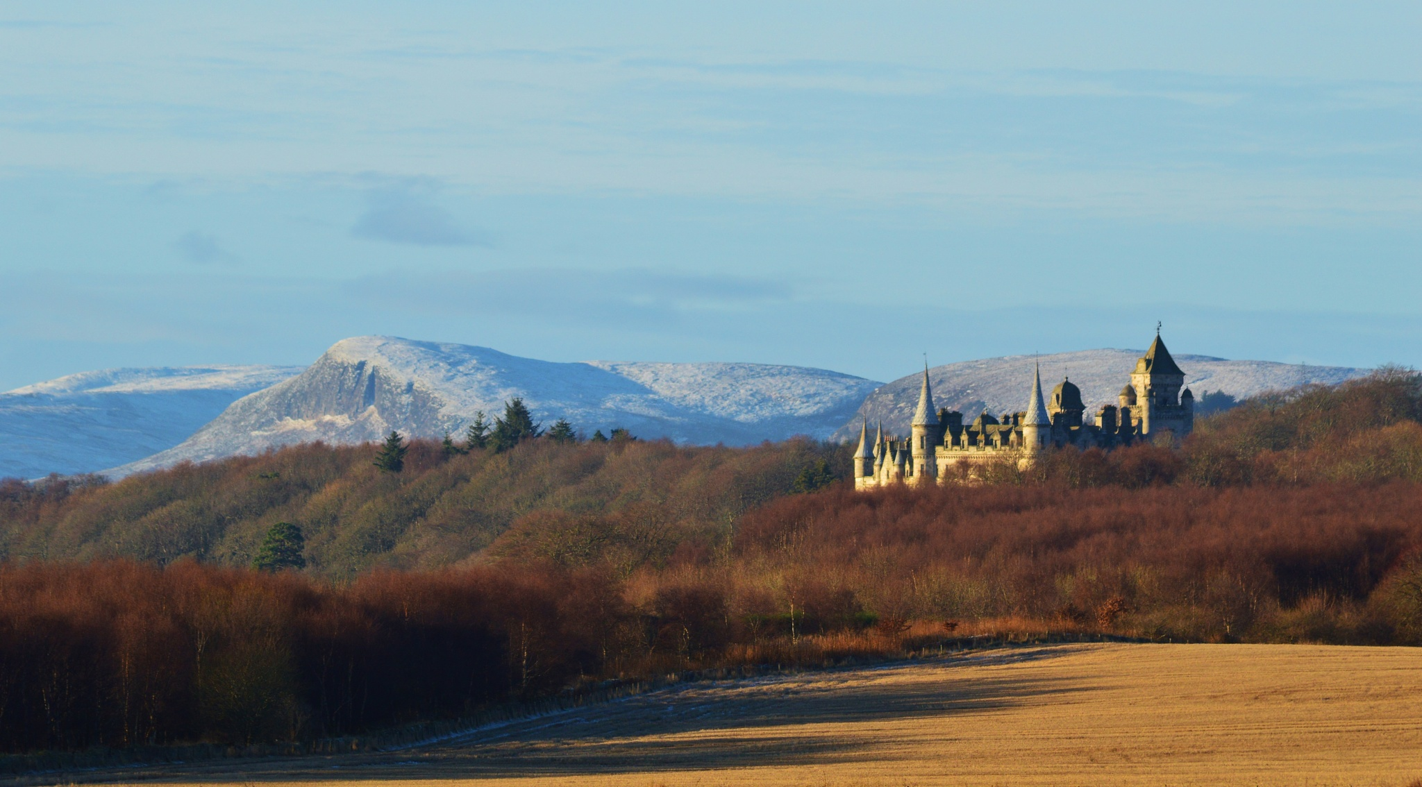 Dunrobin Castle with a light dusting of snow on the hill tops behind. by garybr66