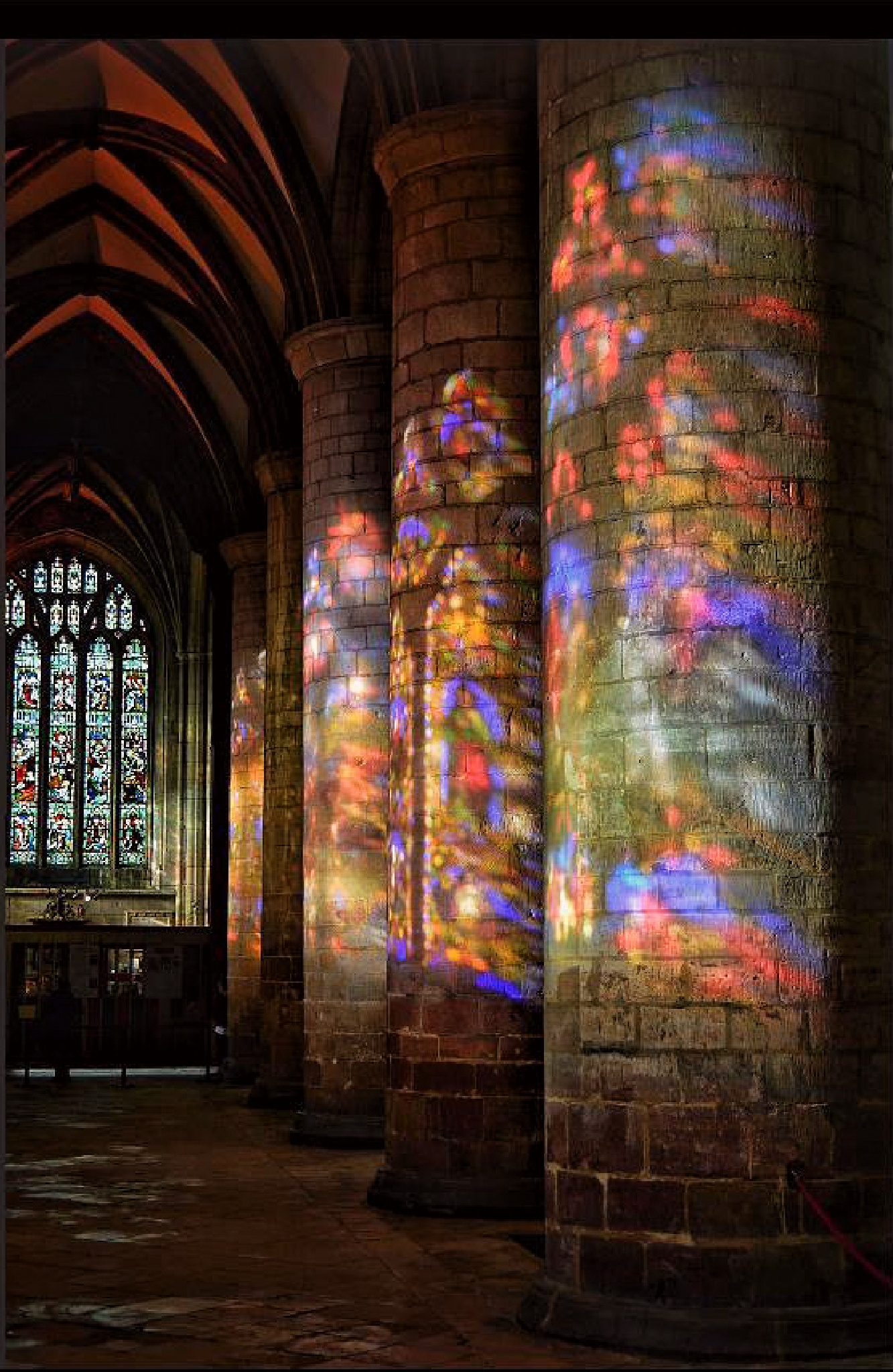 Light through stained glass windows, Gloucester Cathedral, UK by vincent mcnutt
