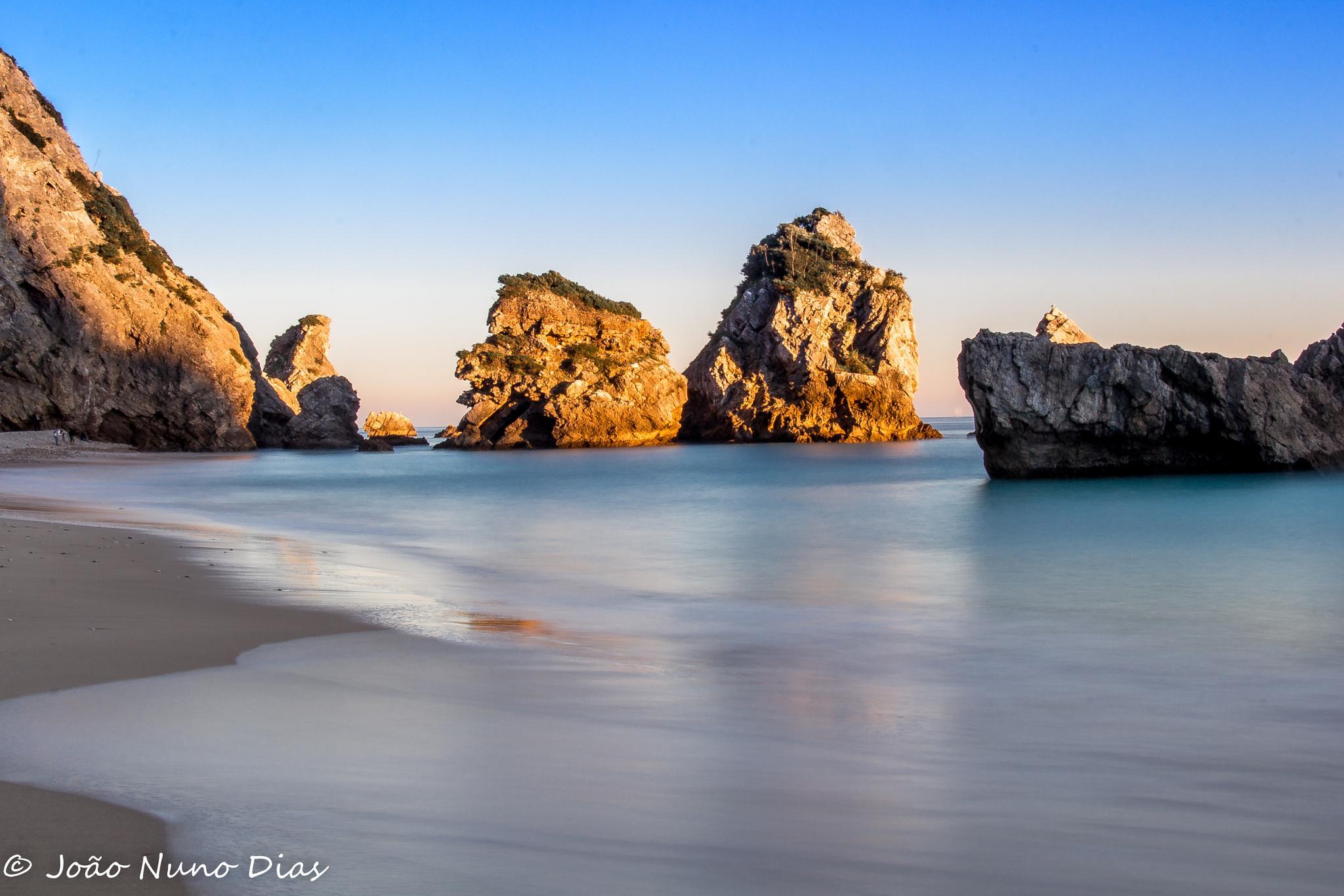 Sunset on the beach by Nuno Dias
