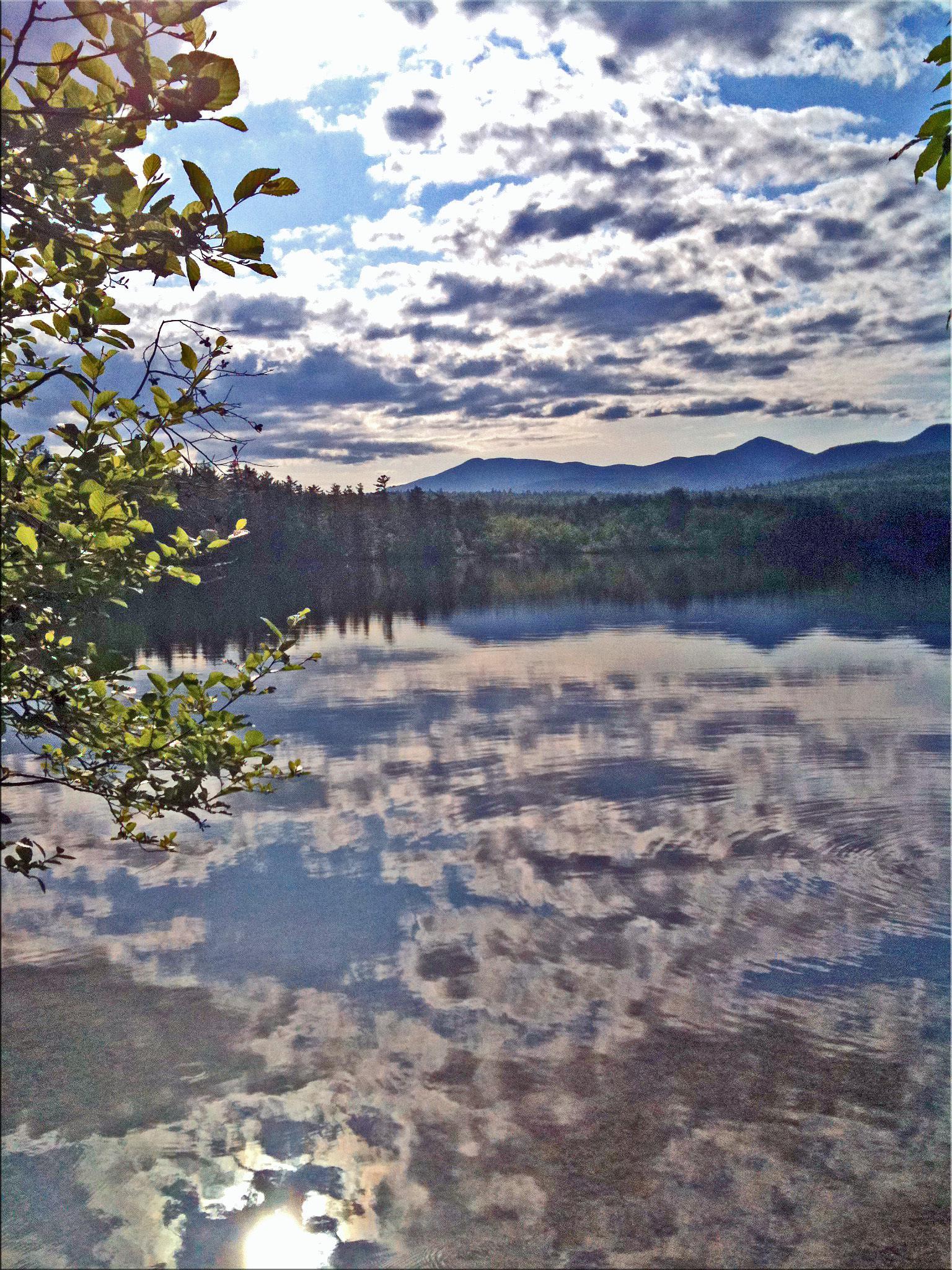 Clouds on water by SassieKatt