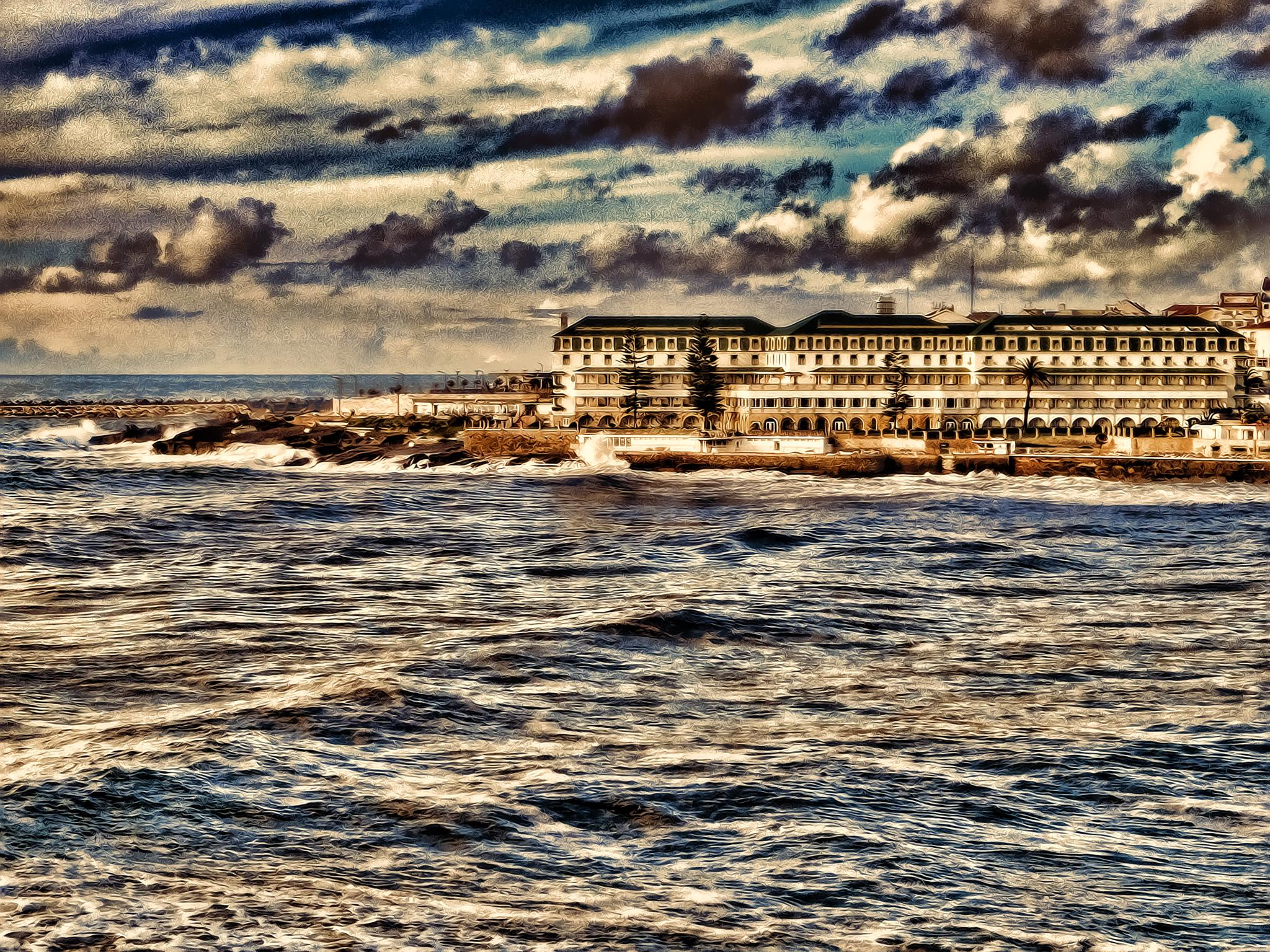 Old hotel on a ocean by Tamara M. Silvestre