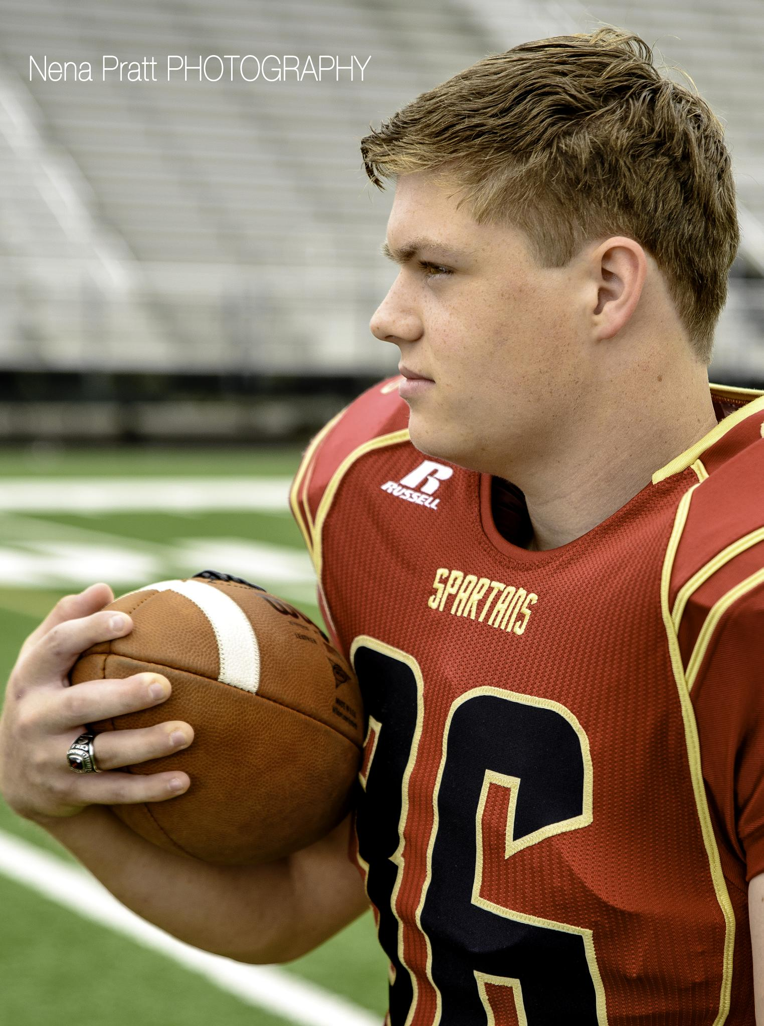 Photo in Sports #sports #football #senior picture #high school #teenager #class ring #portrait