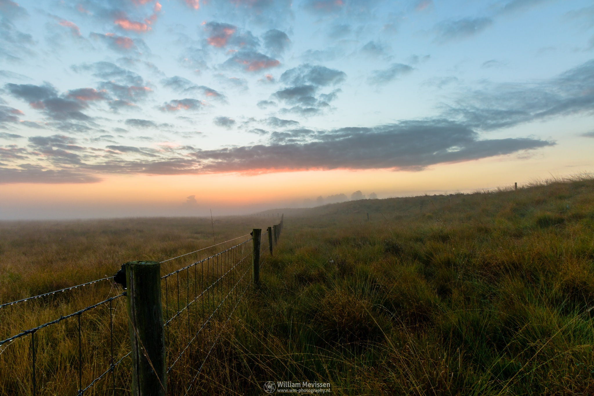 Photo in Landscape #sunrise #orange #sunlight #light #tree #sky #clouds #landgoed #landgoed de hamert #estate #twilight #mist #misty #fog #foggy #de hamert #hamert #maasduinen #noord-limburg #limburg #wellerlooi #national park #nature #limburgs landschap #mistic #path #fence
