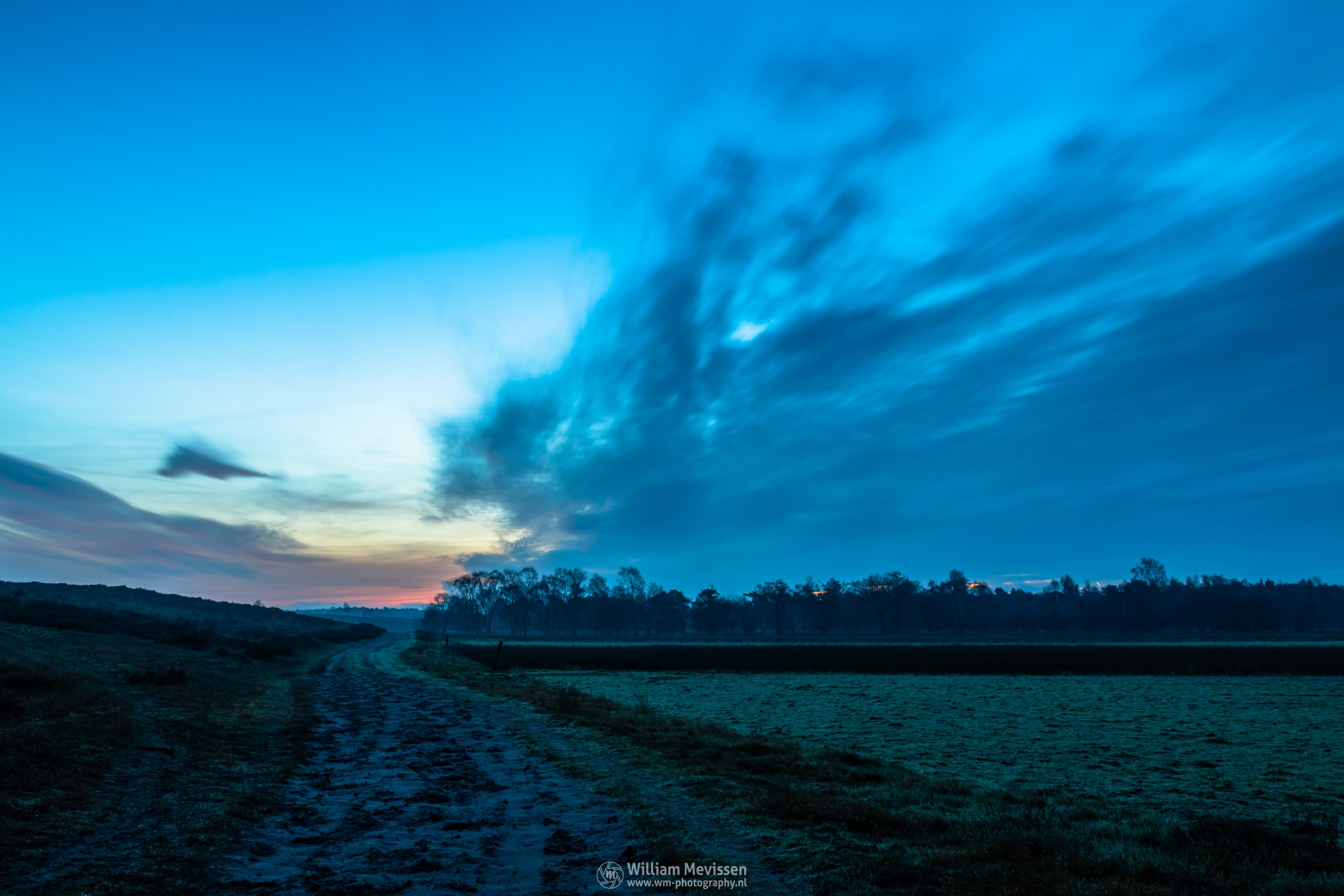 Photo in Landscape #bergerheide #forest #woods #heathland #dirt #road #path #maasduinen #limburg #noord-limburg #nieuw-bergen #bergen #national park #nature #sand #dunes #sanddunes #trees #fields #sky #le #long exposure #30 seconds #twilight #red #orange #blue #yellow #cold #winter