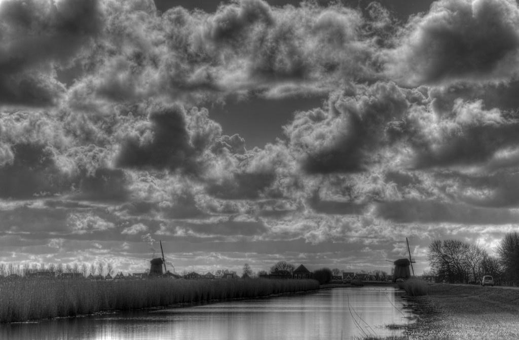 Mills, water and clouds by Watze D. de Haan