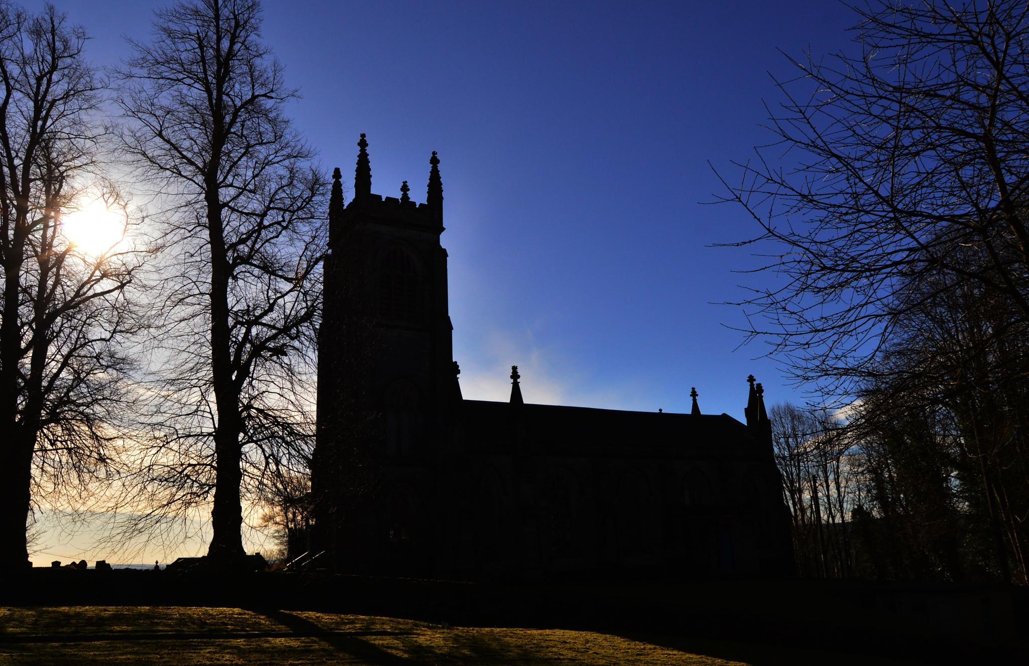 Church in silhouette by John White