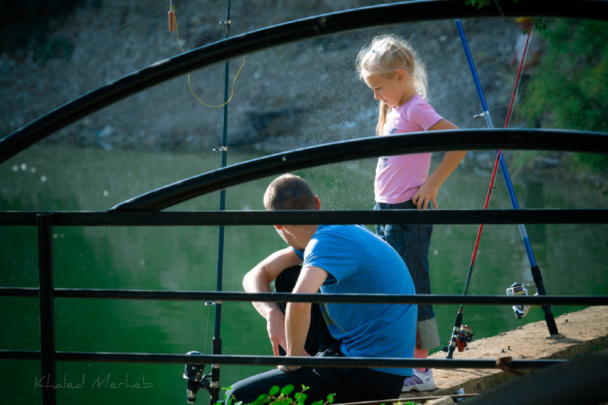 A father-daughter team fishing together.. by khaledMerheb