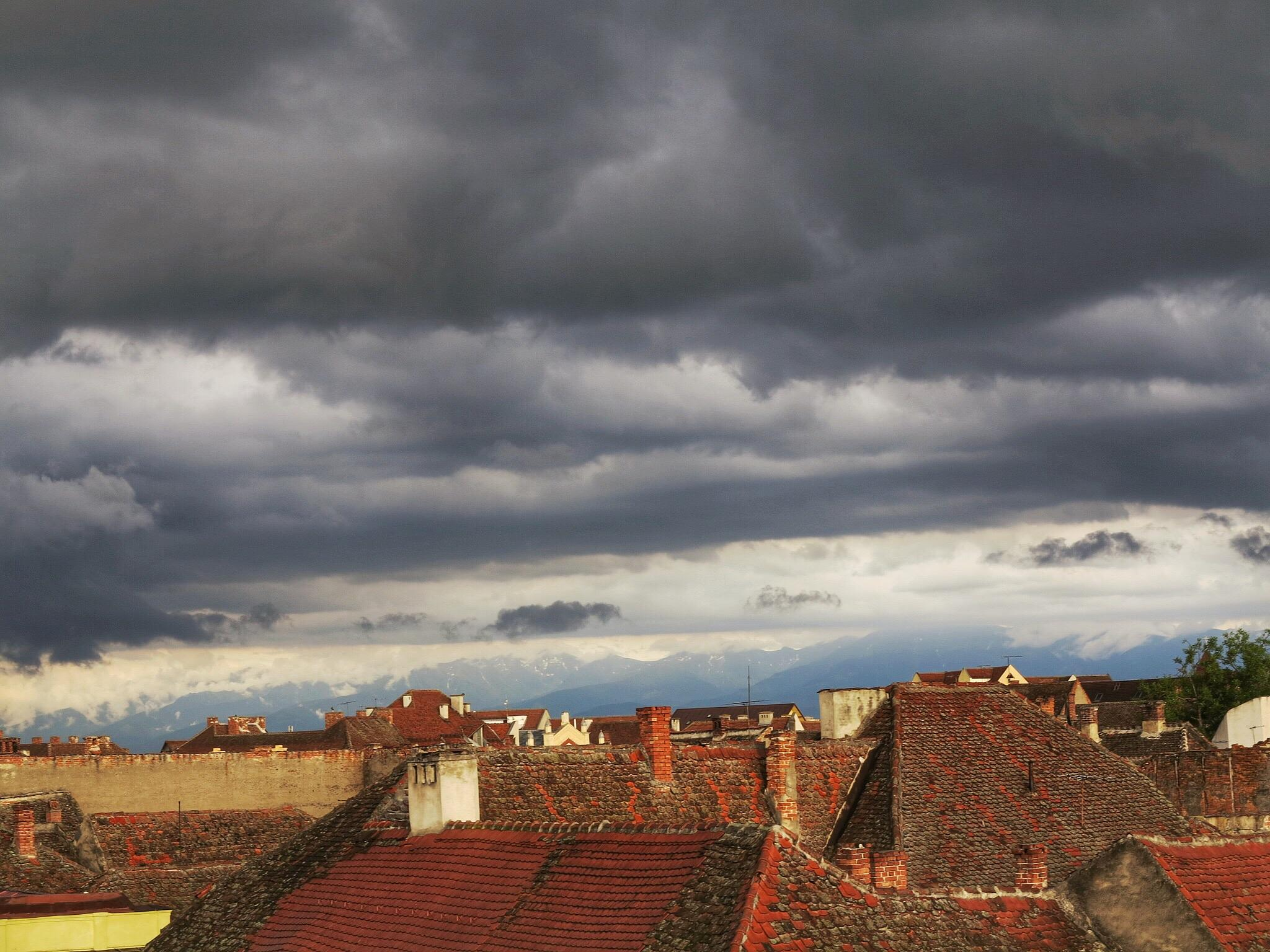 Clouds,Mountains & Red Roofs by Adi Gli