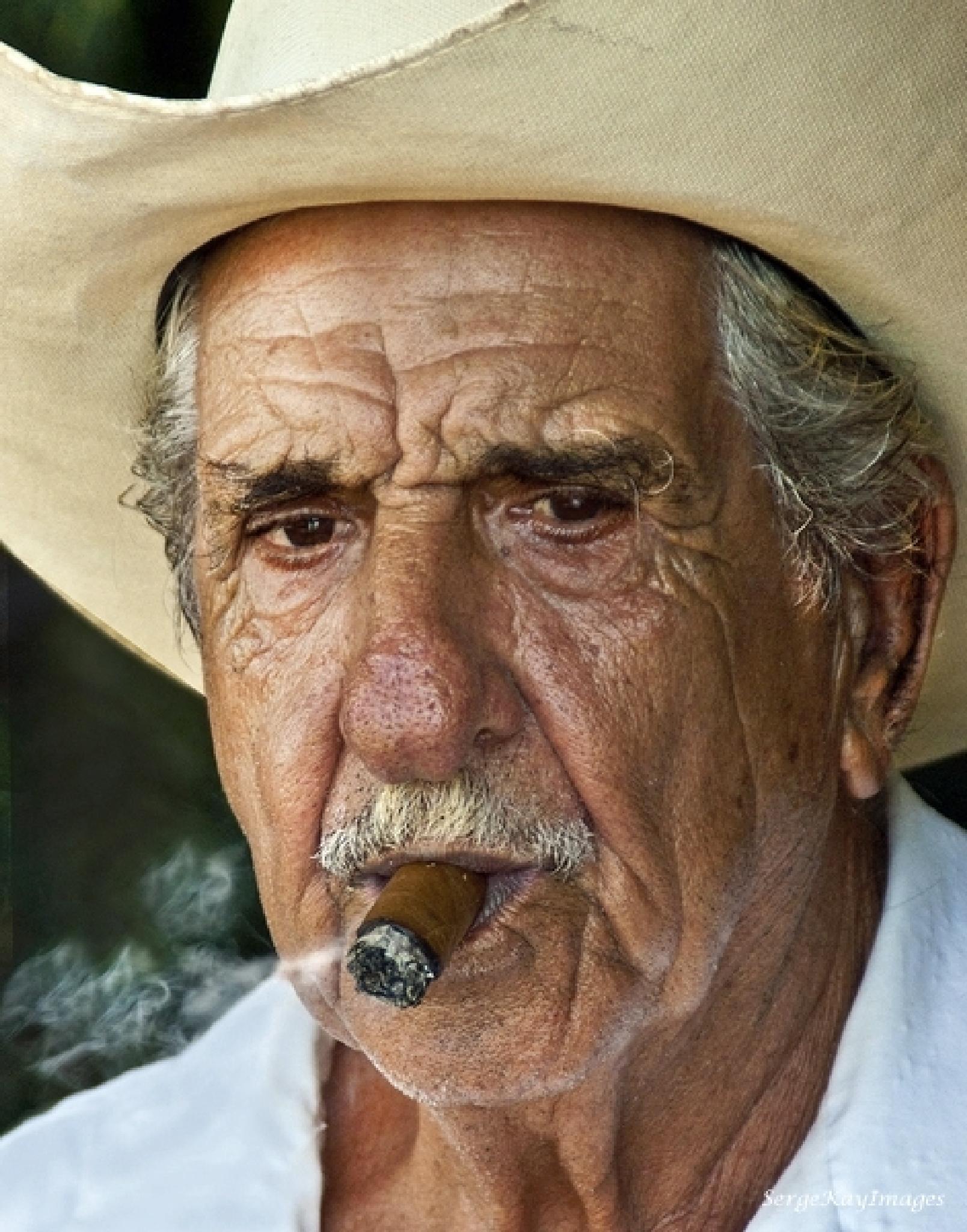 Cuban enjoying his Cigar by Serge Kay
